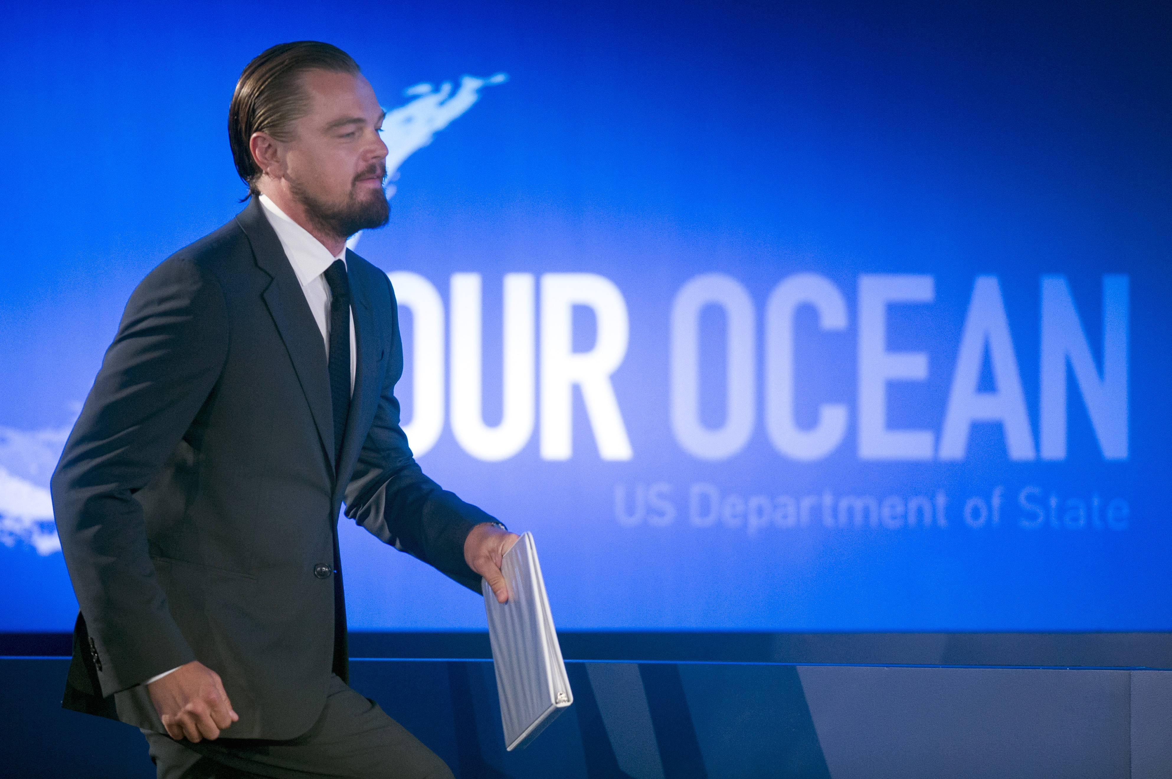 Actor Leonardo DiCaprio walks onstage to speak Tuesday at the State Department's 'Our Ocean' conference at the State Department in Washington.