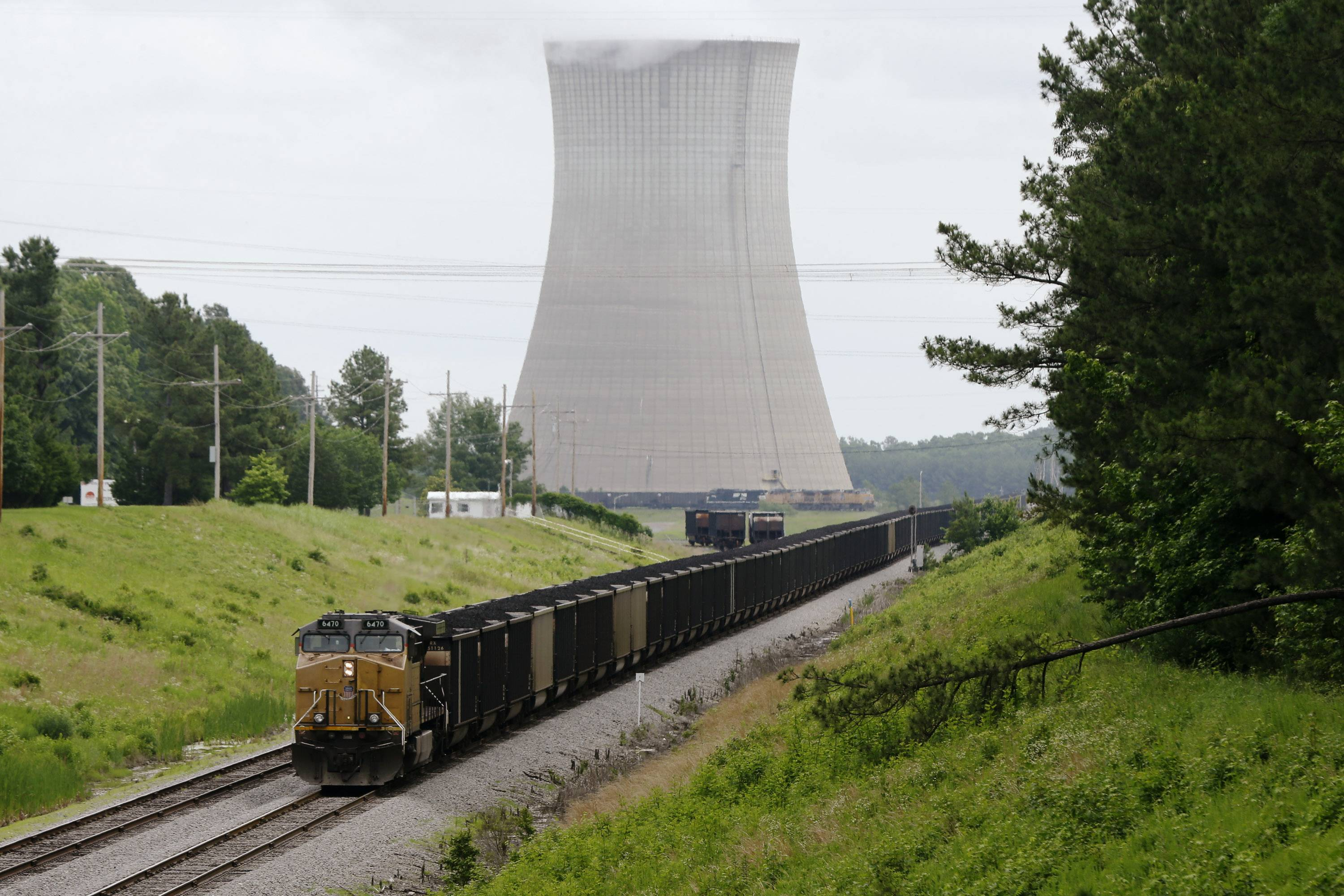 A coal train stops near White Bluff power plant near Redfield, Ark. President Barack Obama's new pollution limits for power plants have set off an avalanche of information about what the rules will cost, how they'll affect your health, and how far they'll go toward curbing climate change.