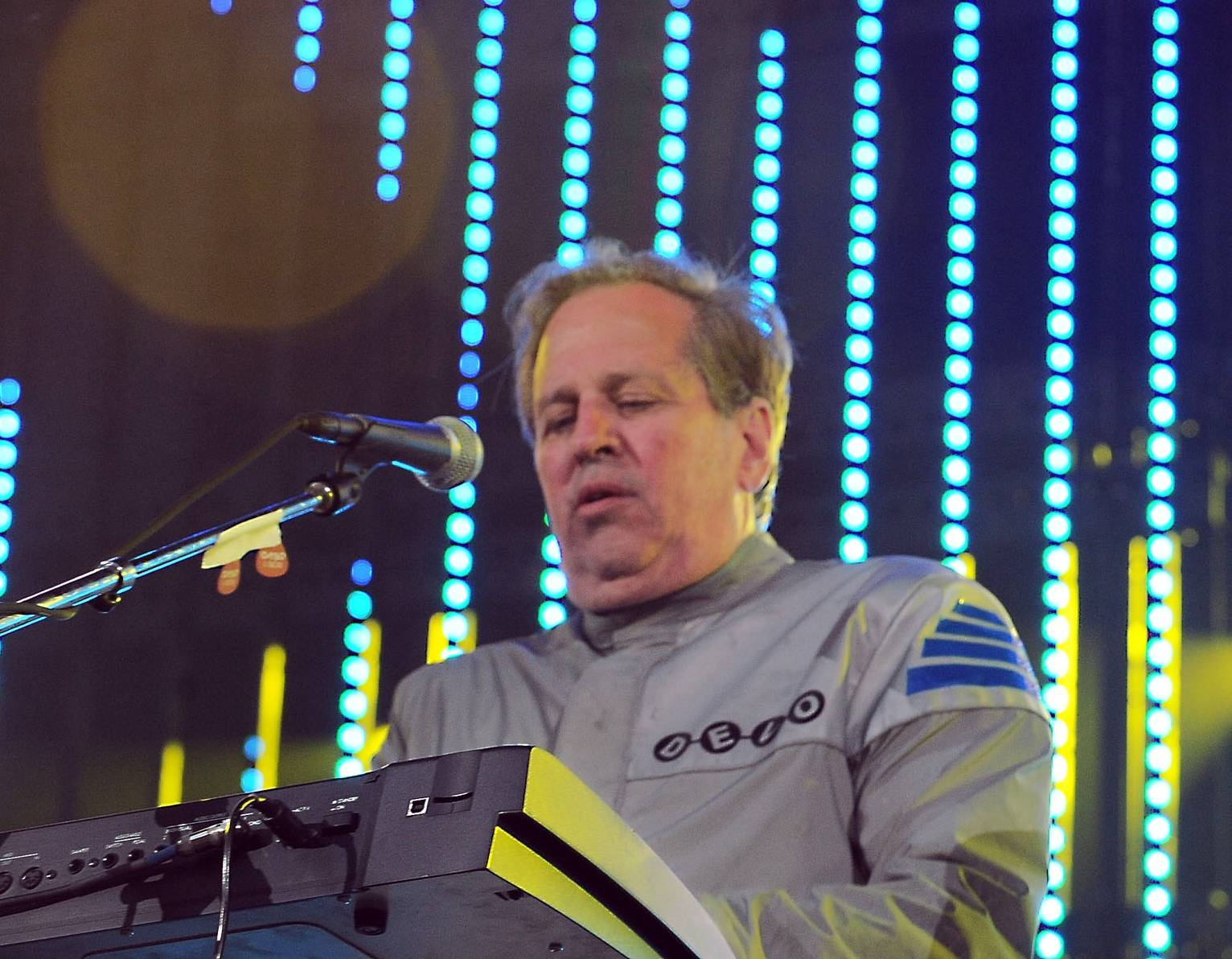 Devo guitarist Bob Casale, pictured here in 2010, passed away suddenly earlier this year, leaving his family with unexpected financial pressures. Devo's current tour will raise money to cover those.
