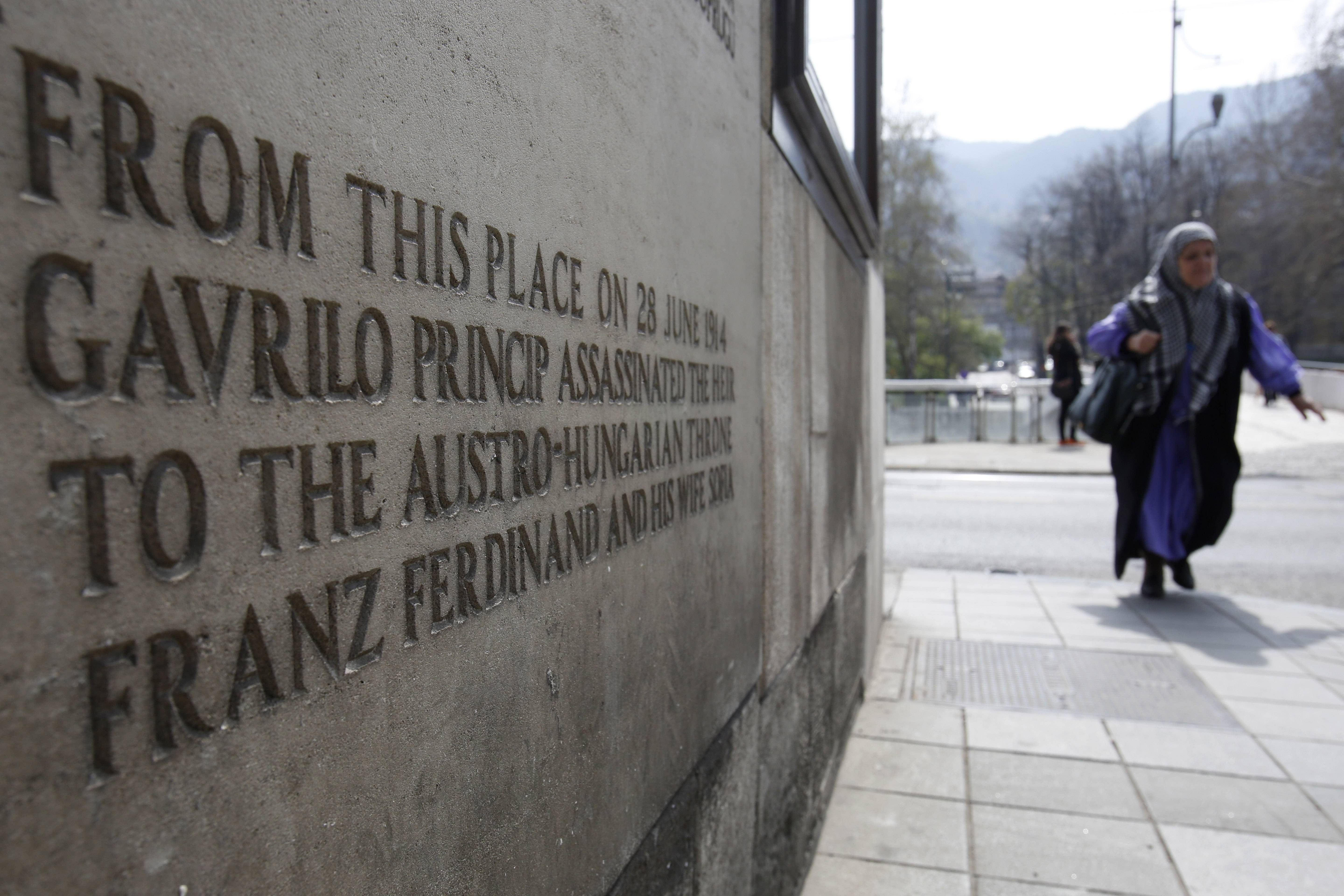 A Bosnian woman passes by the corner where Gavrilo Princip fired the bullet that killed the Austro-Hungarian Empire's crown Prince Franz Ferdinand on June 28, 1914. The assassination soon set in motion a series of events that would eventually lead to World War I.