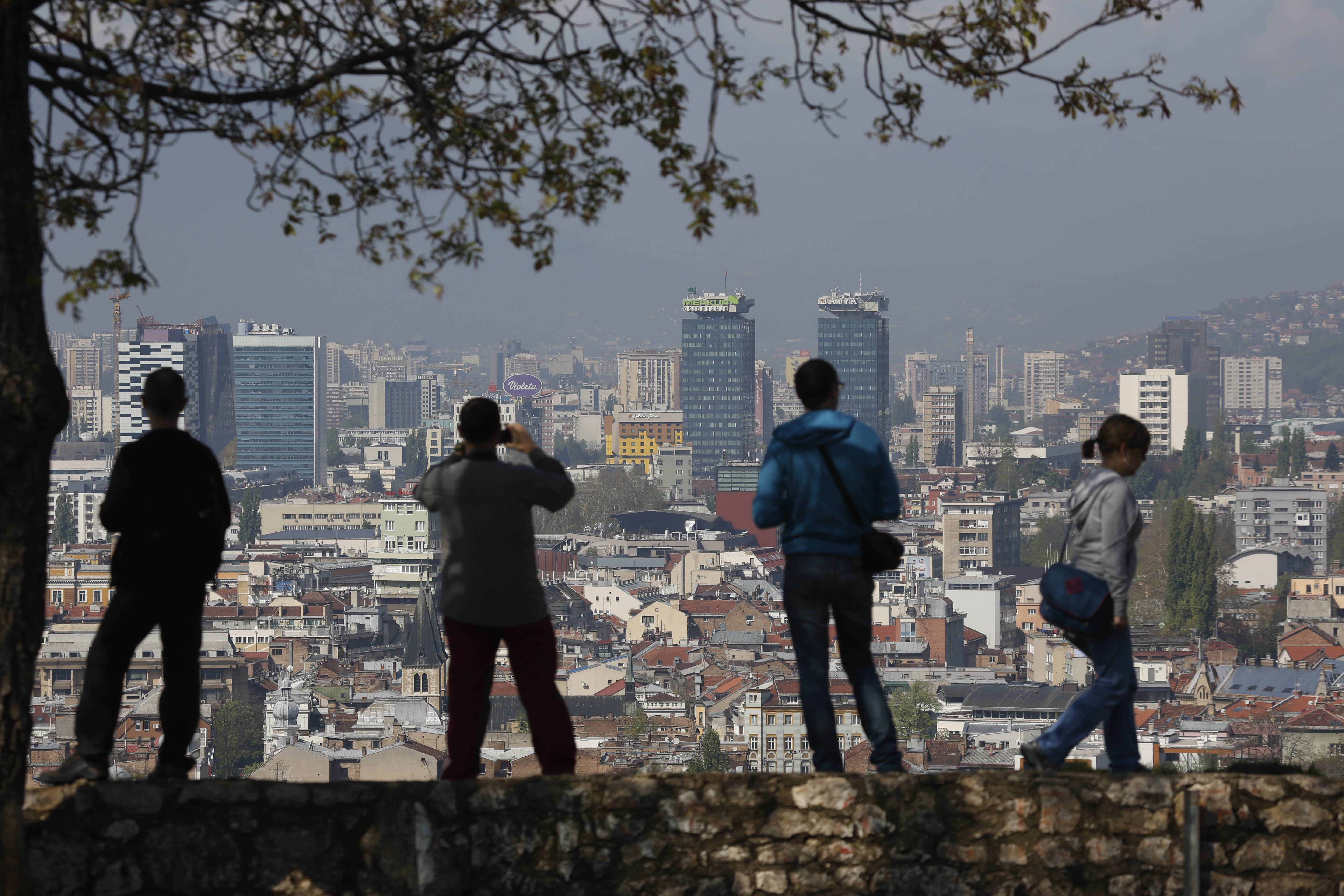Visitors take photos and look at an overview of the city of Sarajevo, Bosnia-Herzegovina.