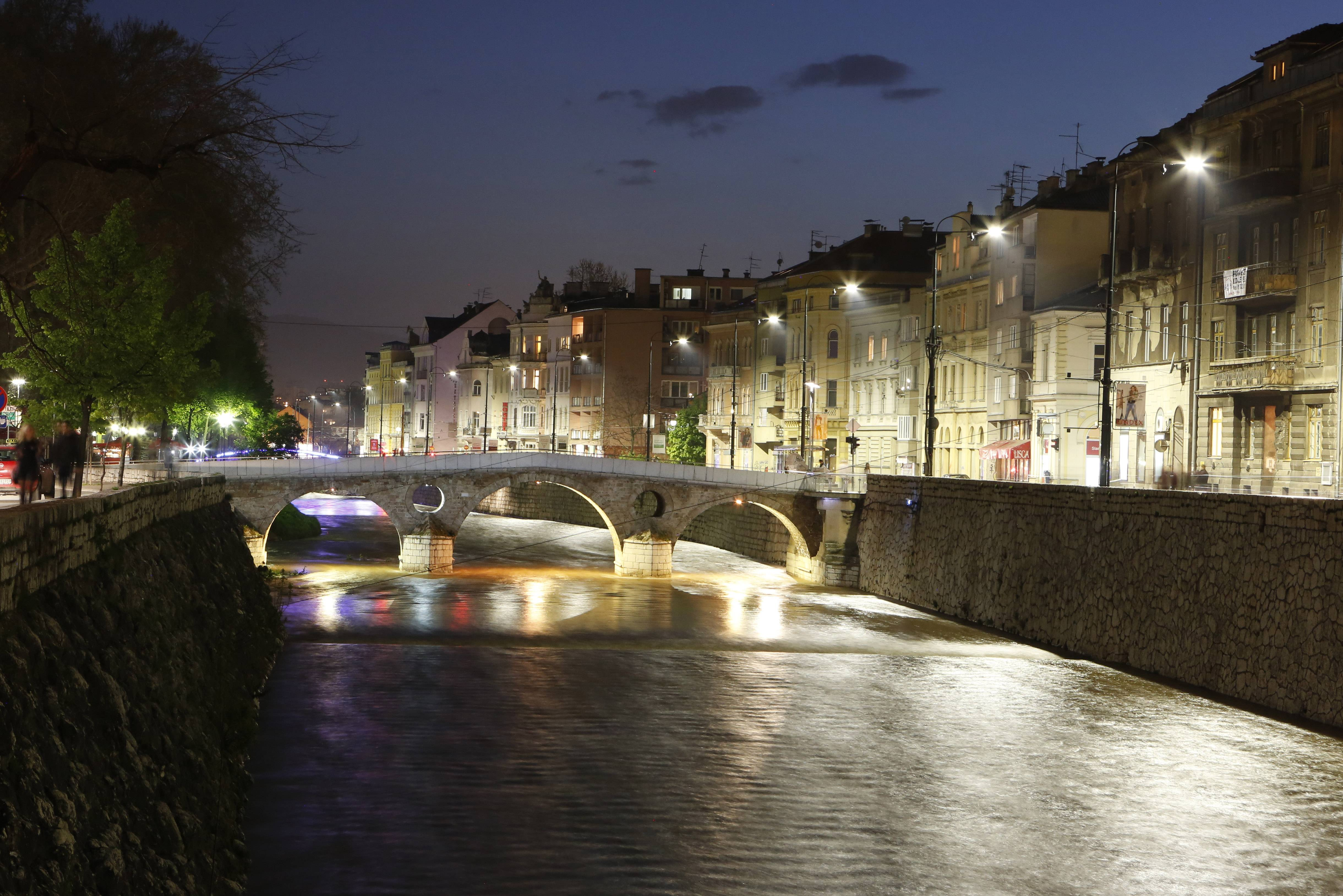Princip Bridge and the surrounding buildings are illuminated at night in Sarajevo, Bosnia-Herzegovina.