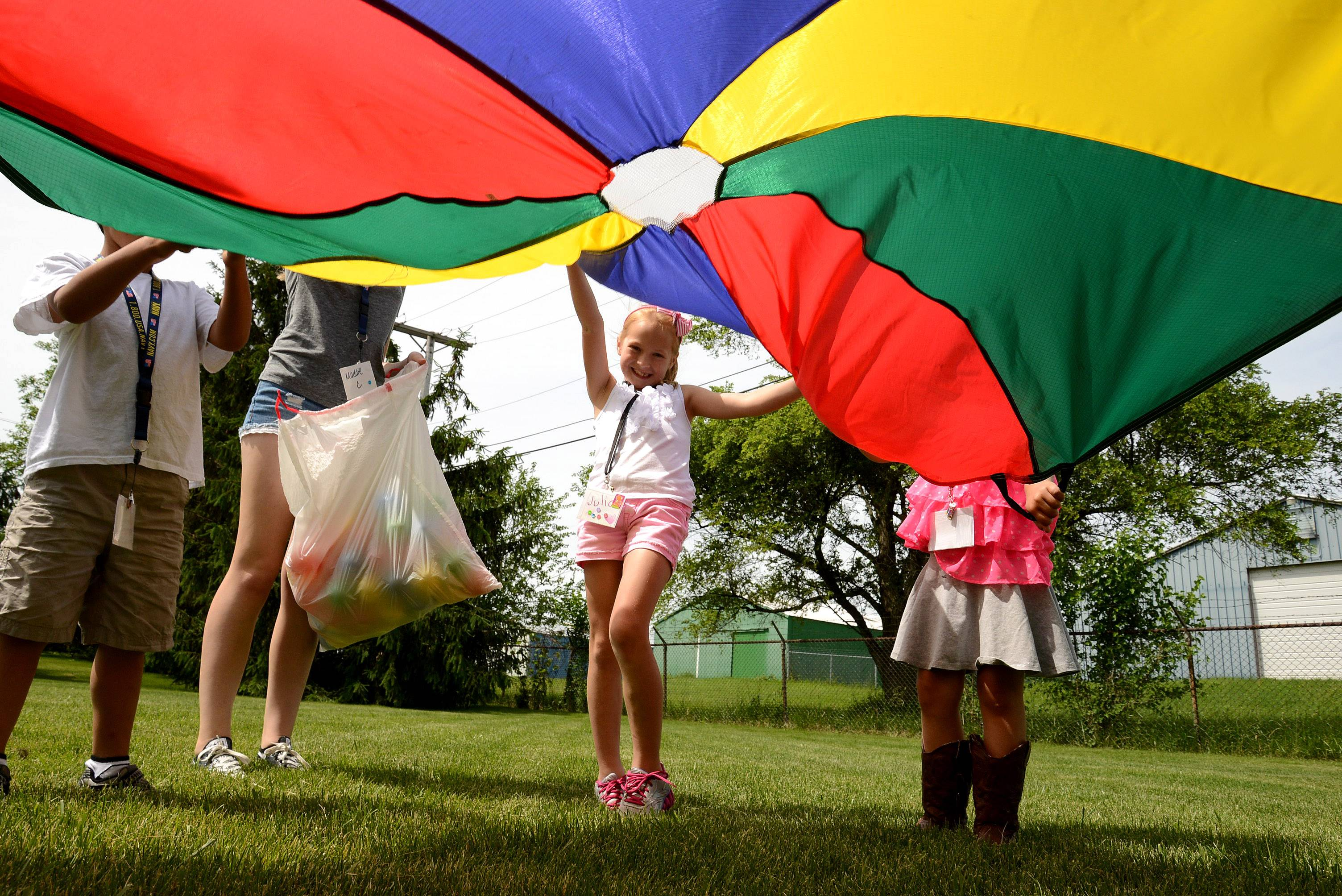 Julia Blasinski, 7, Lindenhurst, participates in the parachute activity during the 4-H Health Rocks Summer Day Camp at the University of Illinois Extension in Grayslake. The camp runs through Wednesday.