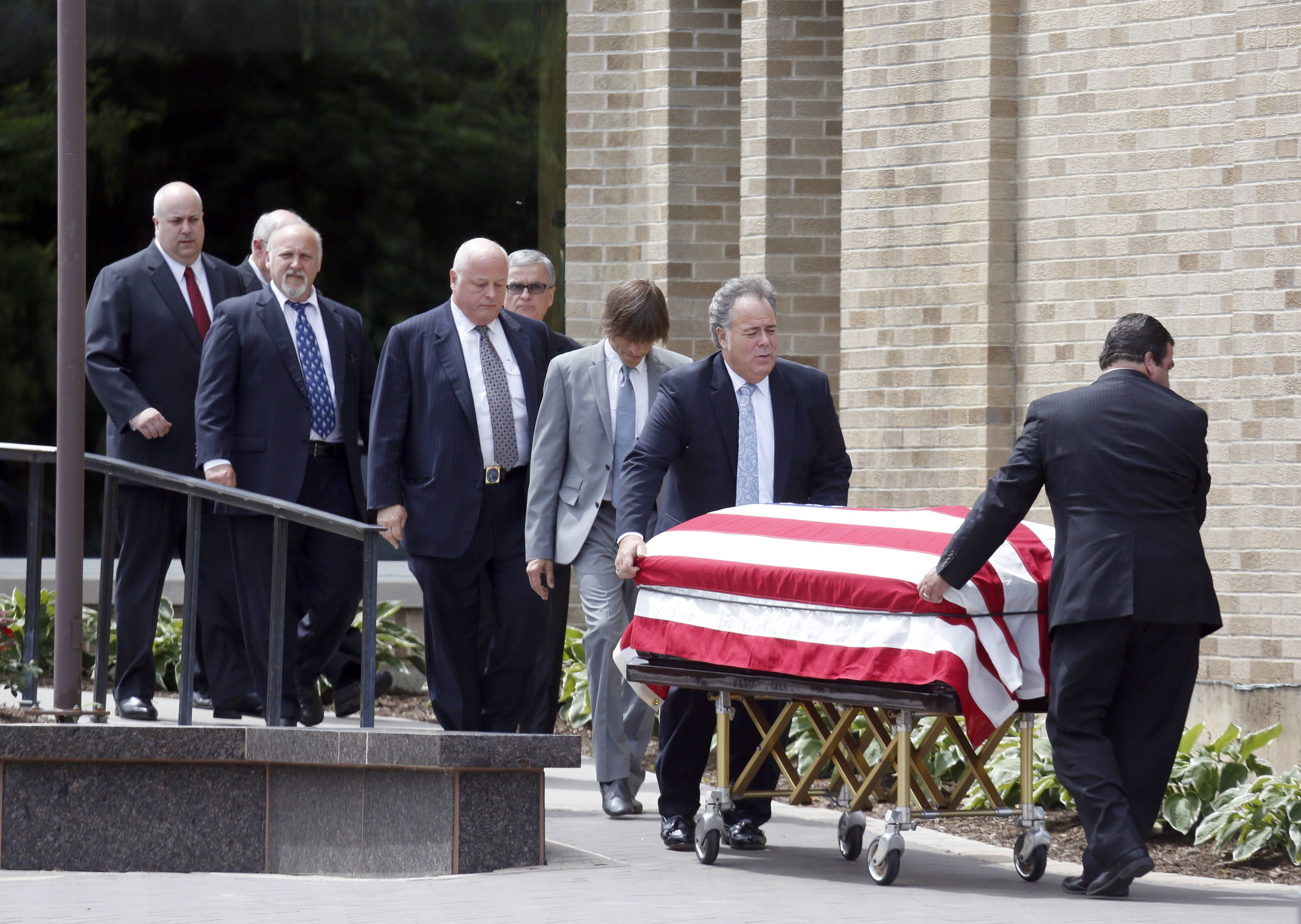 Pallbearers follow the casket of Jack Roeser after his funeral service Tuesday morning at St. Catherine of Siena Catholic Church in West Dundee. Roeser, 90, died Friday.