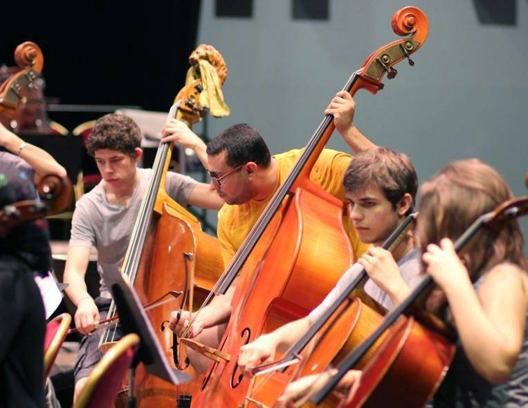 National Youth Orchestra of Iraq bass players are, from left, Chia Sultan, Tom Laffoy and Samir Basim. The players always audition via YouTube.