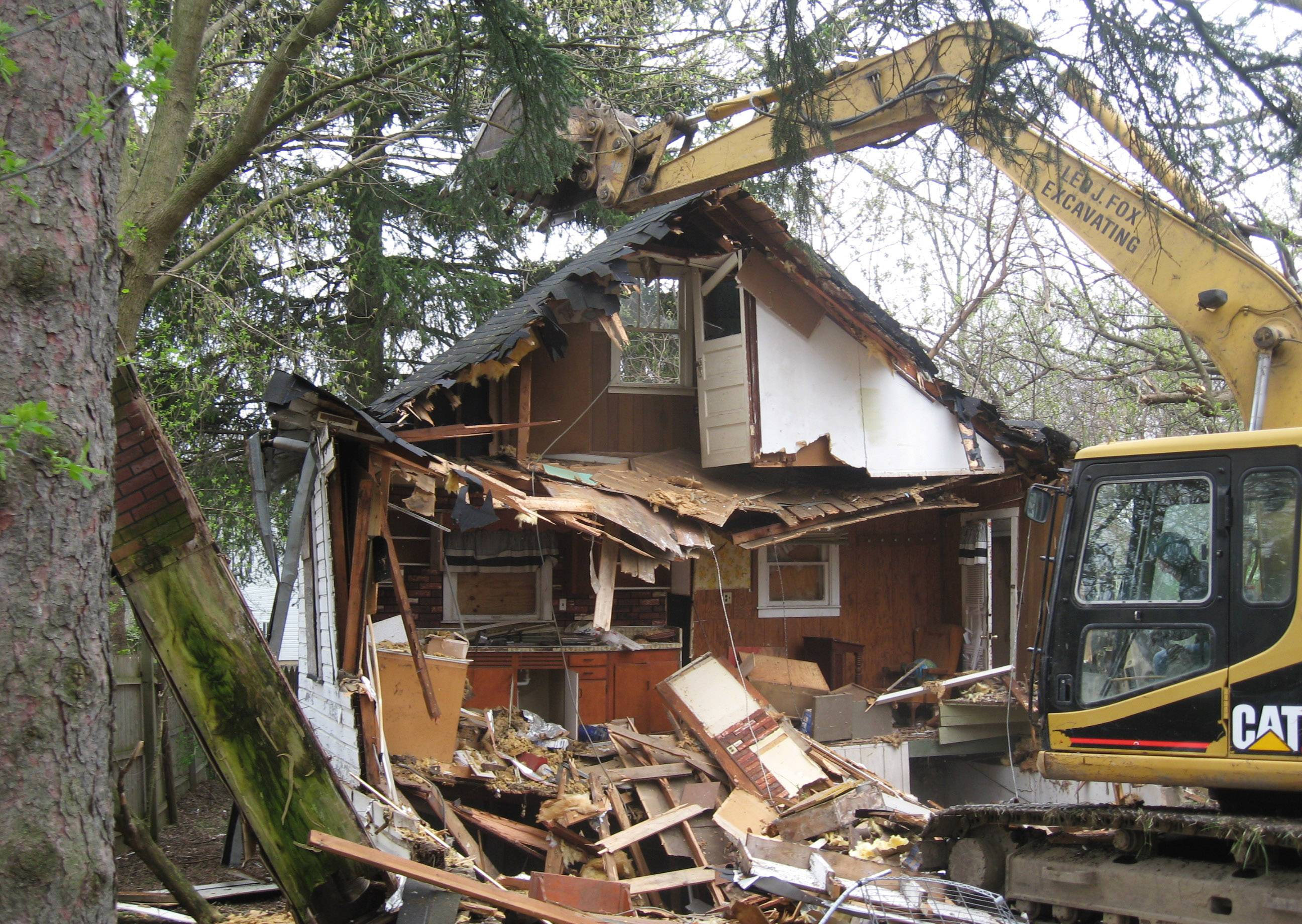 A home is demolished on Orchard Court as part of an ongoing program in Round Lake Beach.