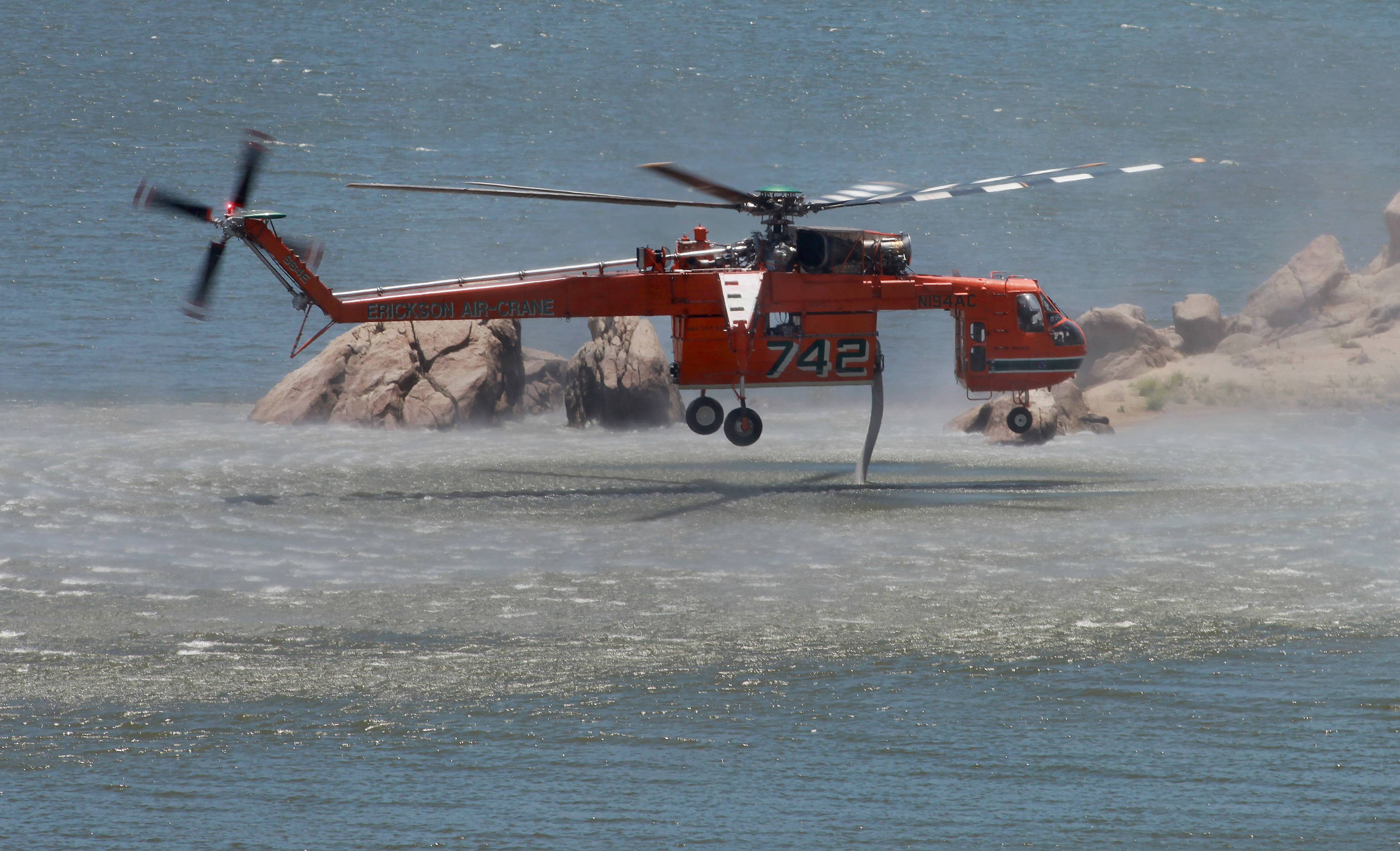 An Erickson Air-Crane loads up from Isabella Lake Sunday before making another water drop on the Shirley Fire that had consumed over 1800 acres as of Sunday afternoon, west of Wofford Heights, Calif.