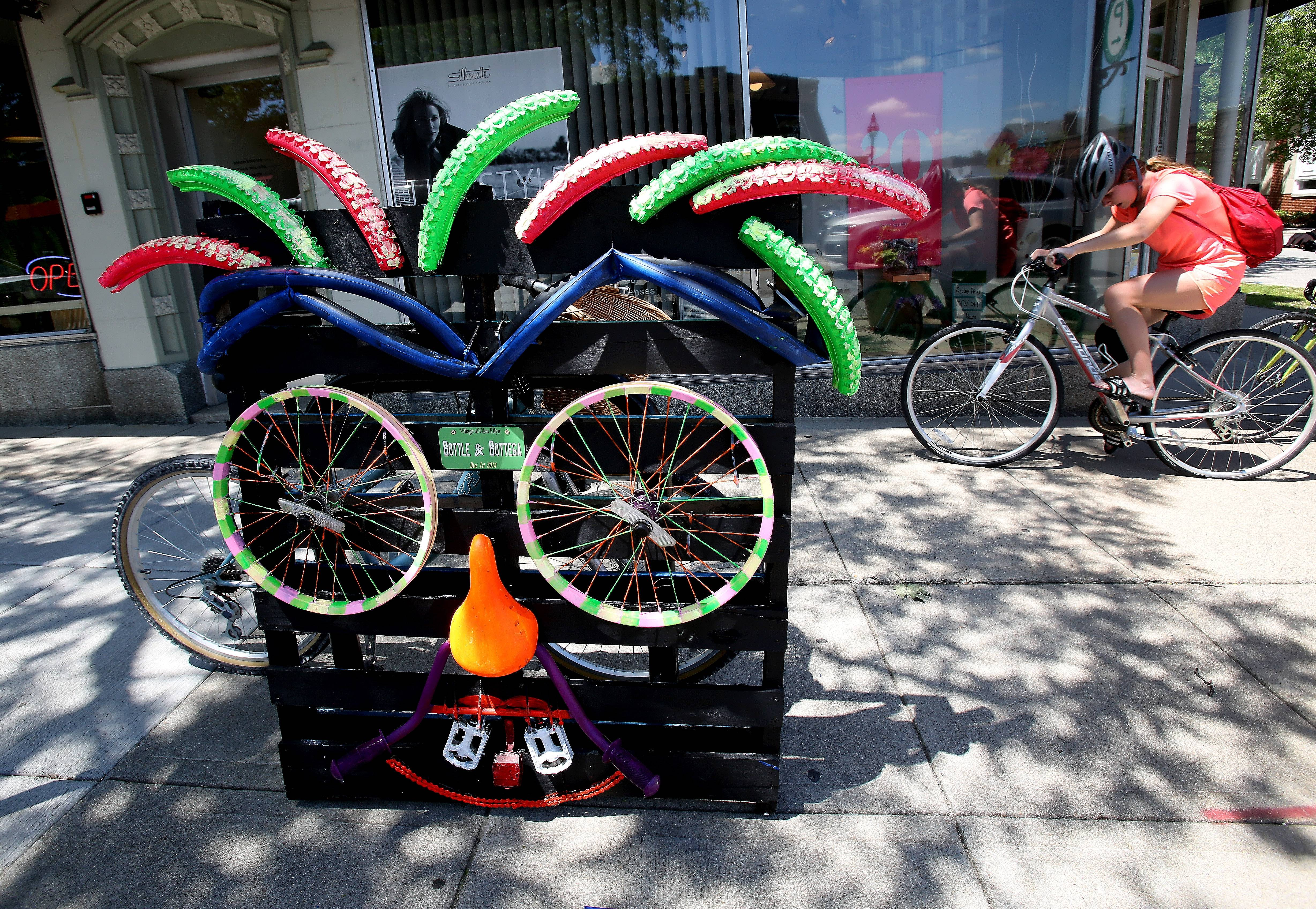 Decorated bikes can be seen in downtown Glen Ellyn as part of a public art exhibit celebrating biking.