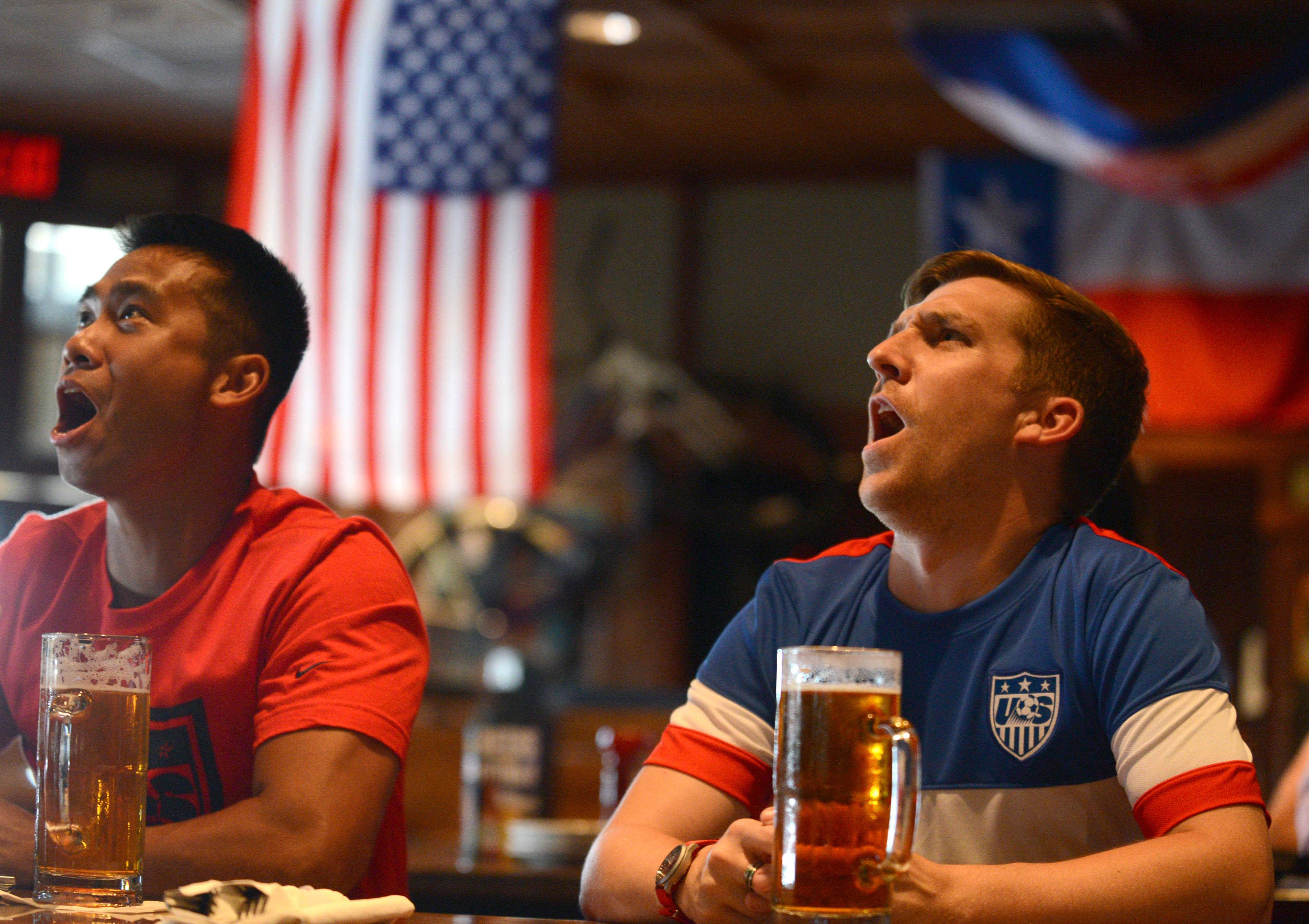 Jonathan Acosta, left, of Addison, and Steve Jenkins, right, of Hoffman Estates fear the news of injured American player Clint Dempsey.