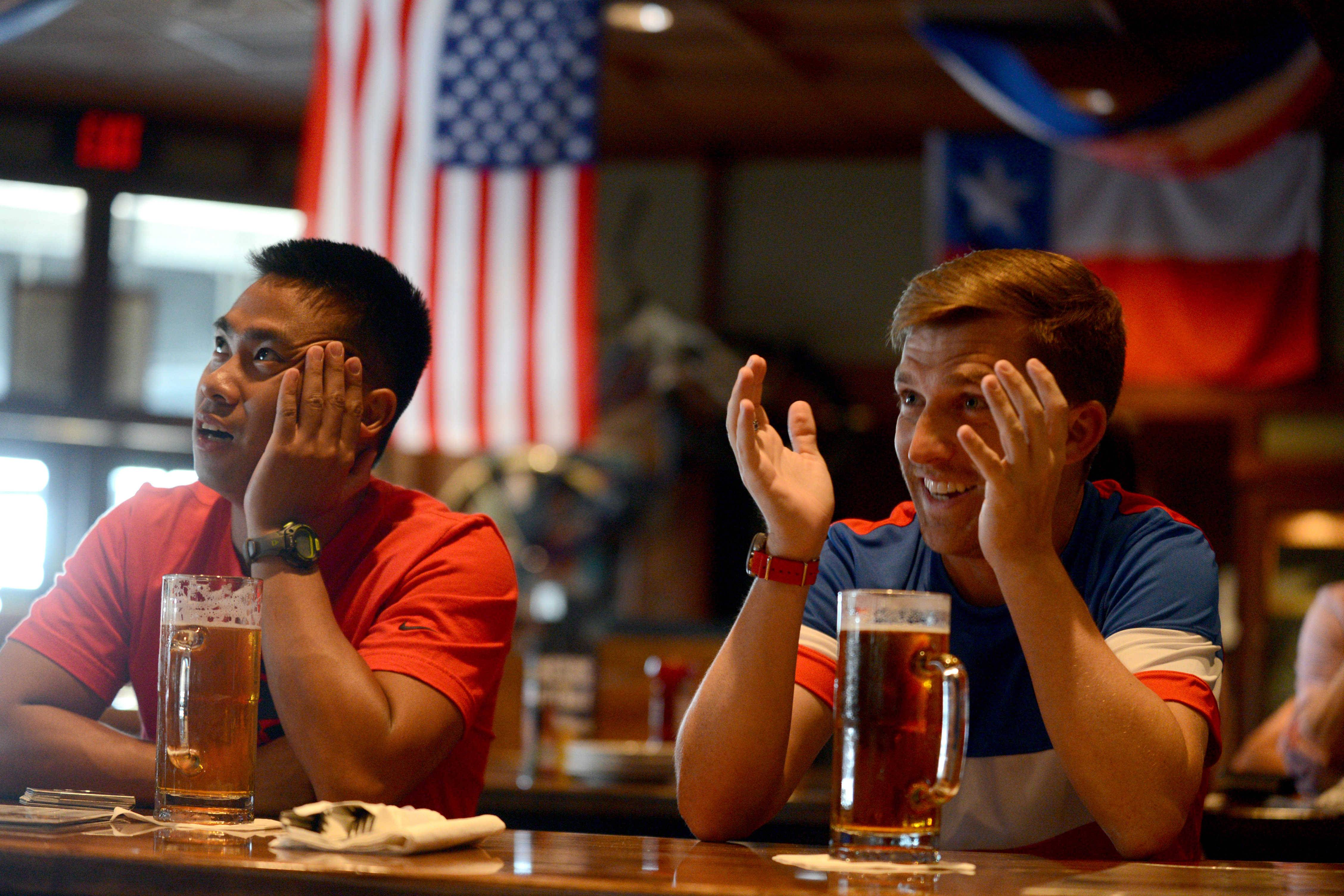 Jonathan Acosta, left, of Addison, and Steve Jenkins of Hoffman Estates don't like the news of Clint Dempsey's injury.