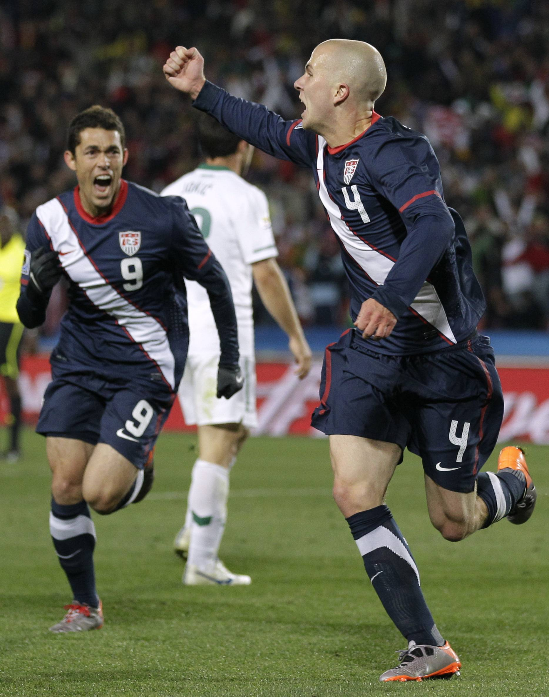Michael Bradley, who spent part of his youth playing soccer in Palatine, reacts to scoring a goal during a 2010 World Cup match as United States teammate Herculez Gomez, left, joins in the celebration. Bradley and his U.S. teammates beat Ghana 2-1 Monday to open this year's World Cup action.