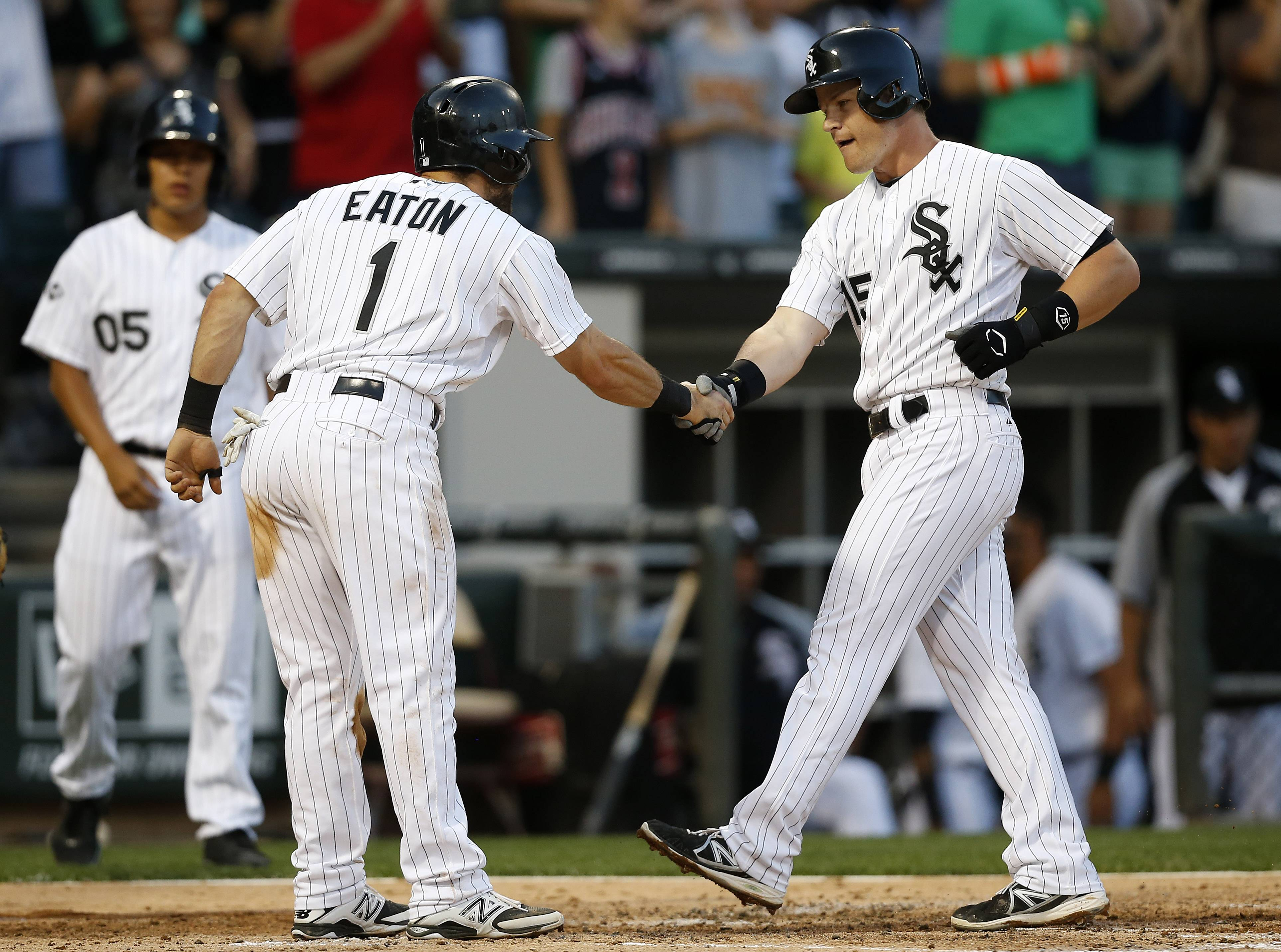 Gordon Beckham, right, celebrates his game-tying, 2-run homer with Adam Eaton in the third inning Tuesday night.