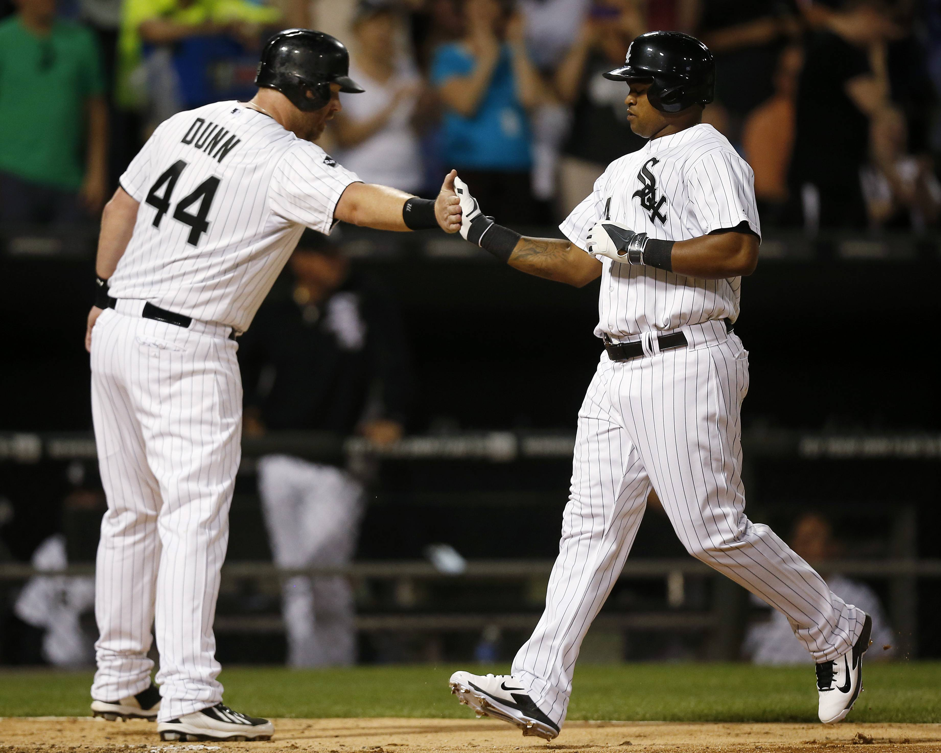 Dayan Viciedo, right, celebrates his two-run home run against the San Francisco Giants with Adam Dunn, who scored, during the fifth inning of a baseball game on Tuesday. Gordon Beckham and Viciedo hit two-run home runs, John Danks pitched effectively into the seventh inning and the White Sox snapped a four-game losing streak with an 8-2 victory over the San Francisco Giants on Tuesday night.