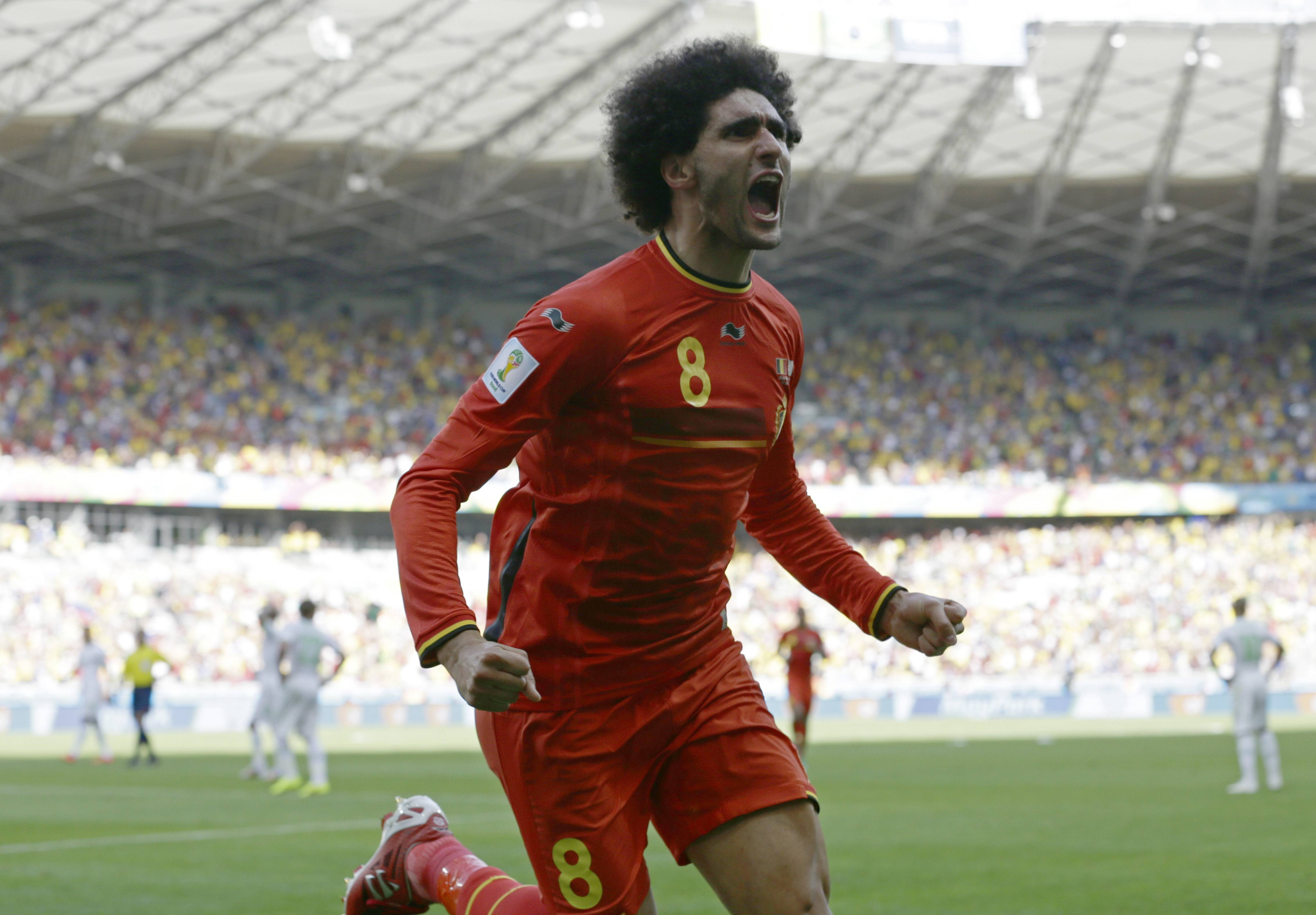 Belgium's Marouane Fellaini celebrates after scoring his side's first goal during the group H World Cup soccer match between Belgium and Algeria at the Mineirao Stadium in Belo Horizonte, Brazil, Tuesday.