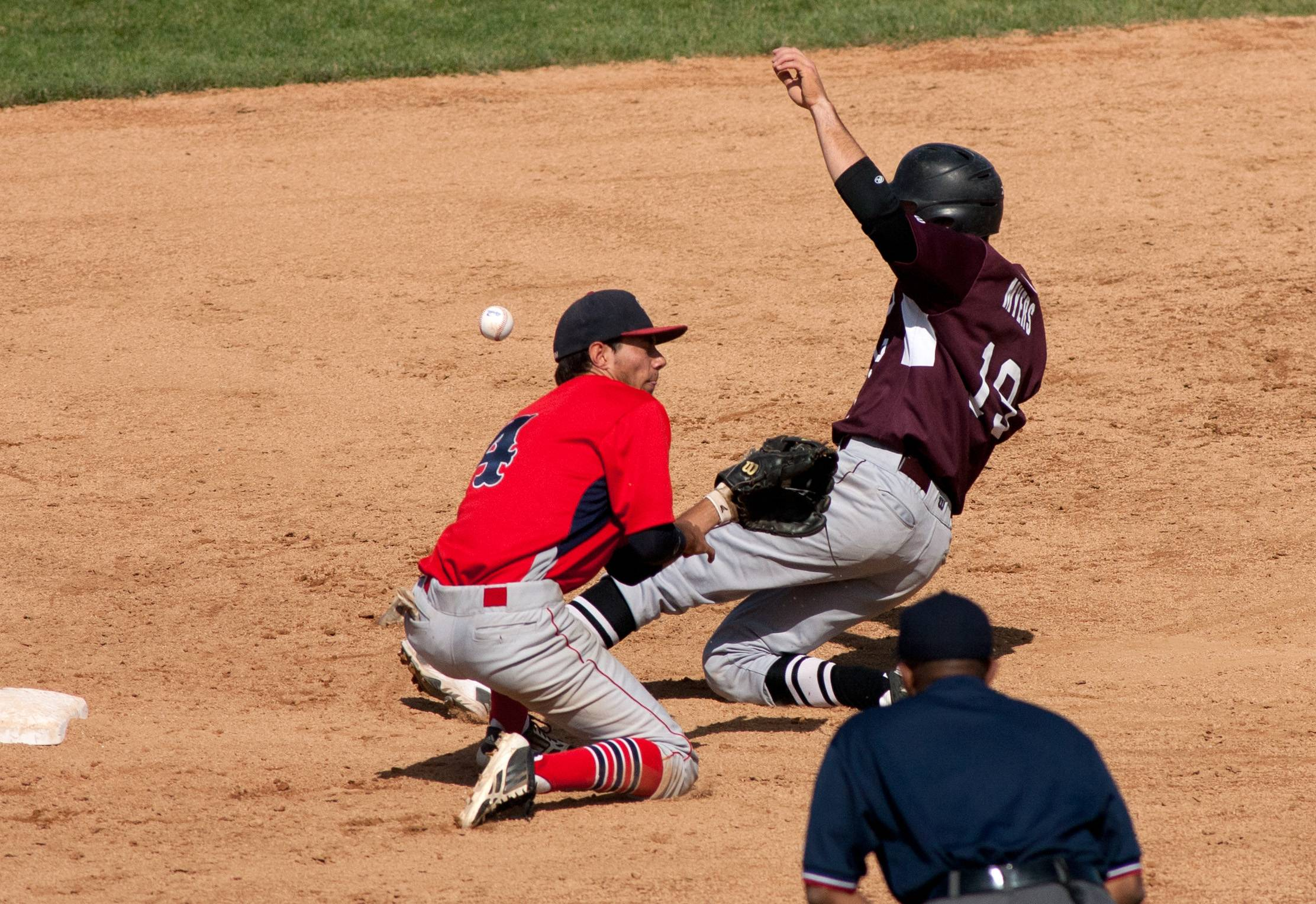 Prairie Ridge's John Myers slides safely into second base past South Elgin's Dane Toppel, during the class 4A state baseball third place consolation game at Silver Cross Field in Joliet.