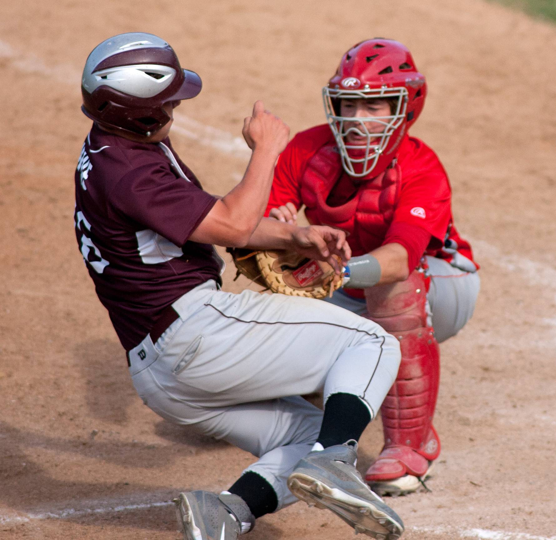 South Elgin catcher Nate Brummel tags out Prairie Ridge's Alec Thune in the sixth inning during the class 4A state baseball third place consolation game at Silver Cross Field in Joliet.