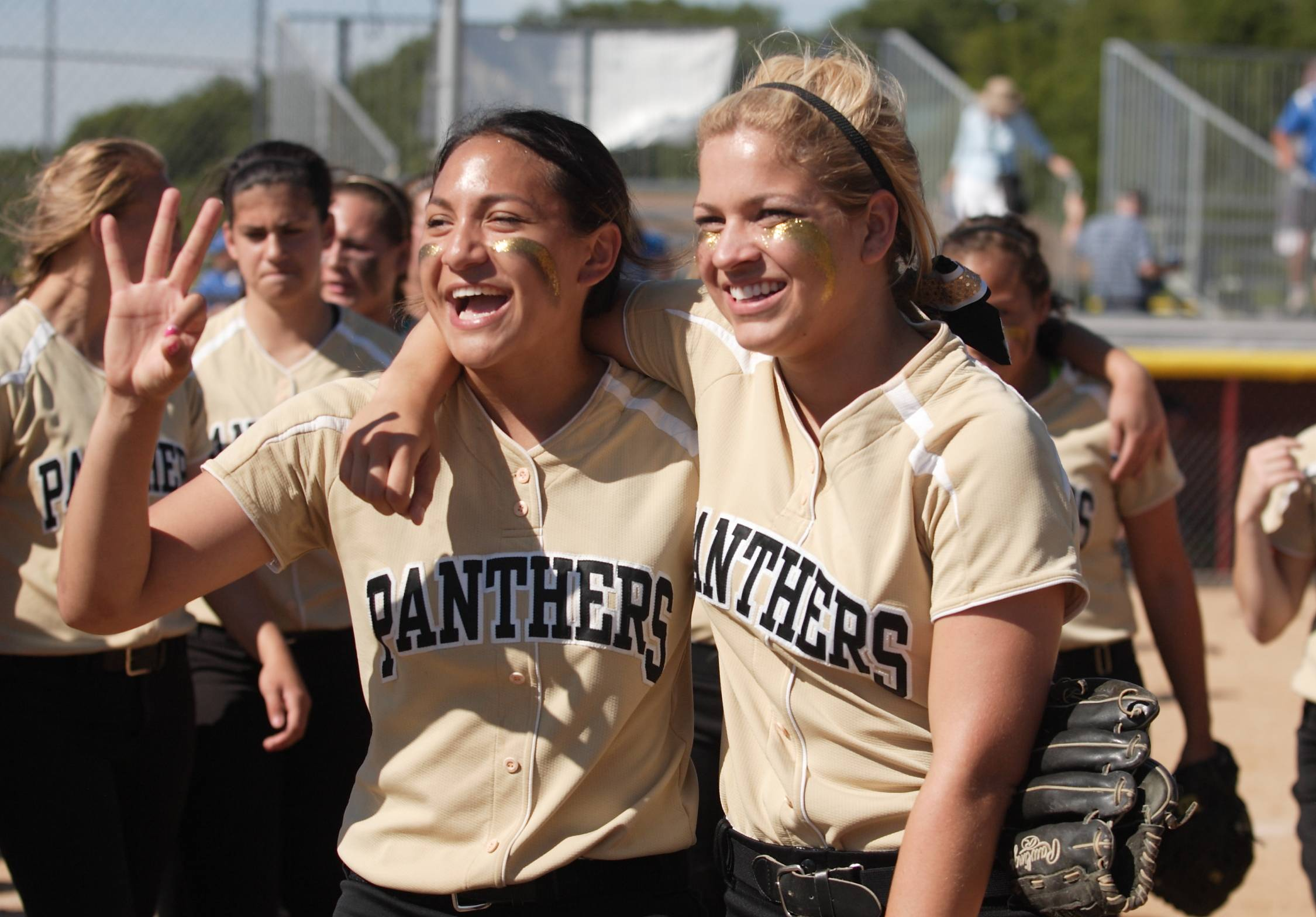 Lauren Gramann and Alex Caliva celebrate the Panthers' third-place wind after their IHSA Class 4A game on Saturday. Glenbard North defeated Lincoln-Way East, 6-0.
