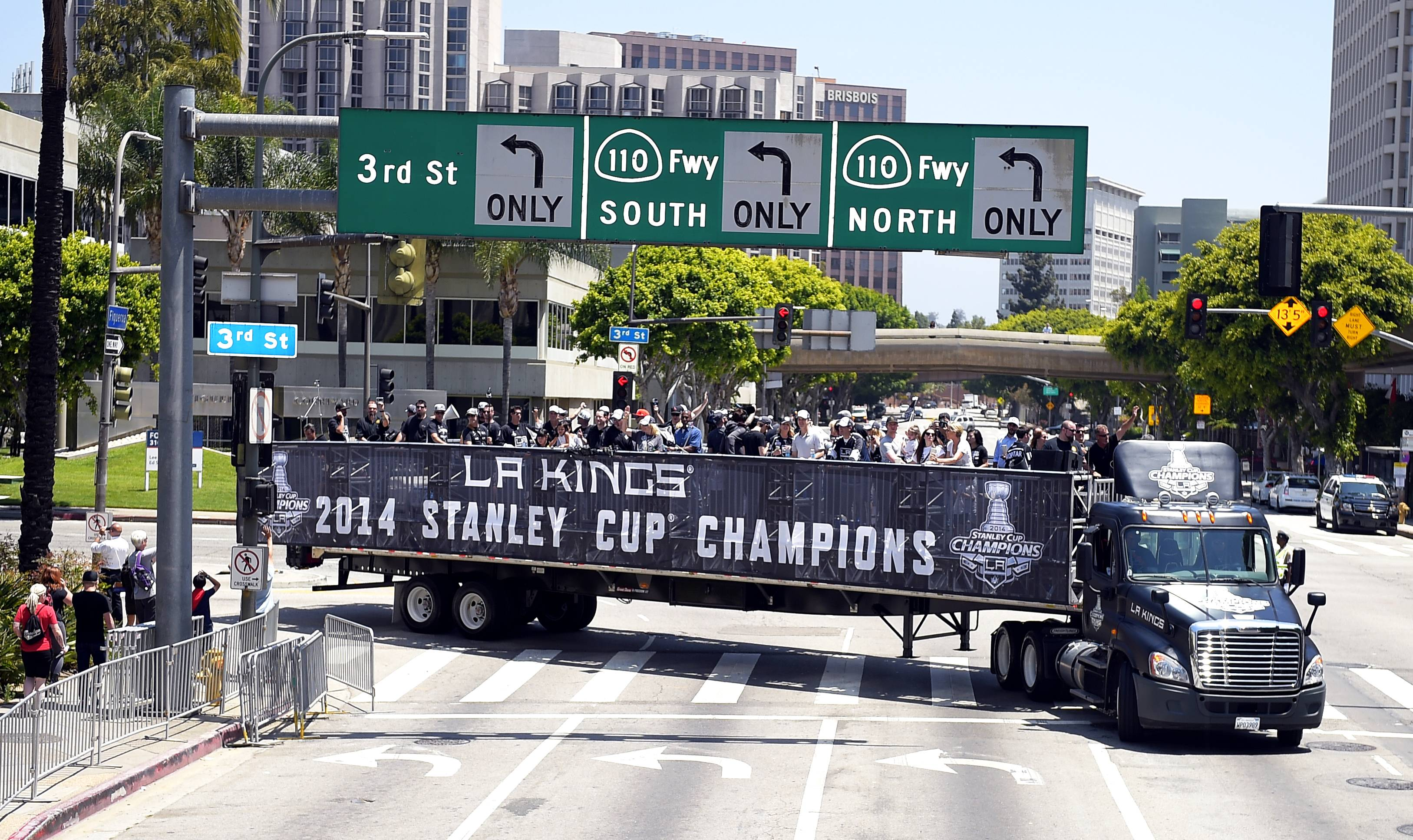 Members of the Los Angeles Kings NHL hockey team ride through downtown Los Angeles to celebrate the Kings' second Stanley Cup championship in three seasons. The Kings defeated the New York Rangers for the title.