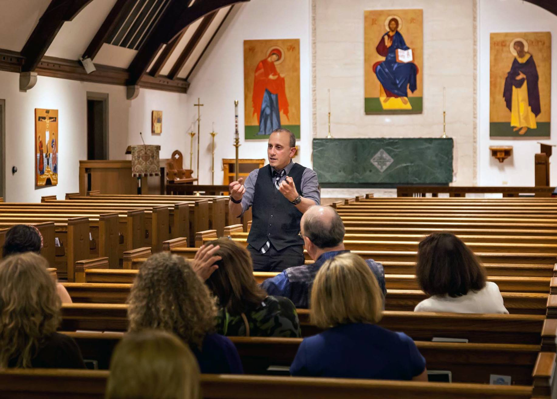Joseph Malham engages his Opening Night audience with his wit and wisdom.  His new Triptych is shown above the altar at St. Mark's Episcopal Church.Peter Vagt