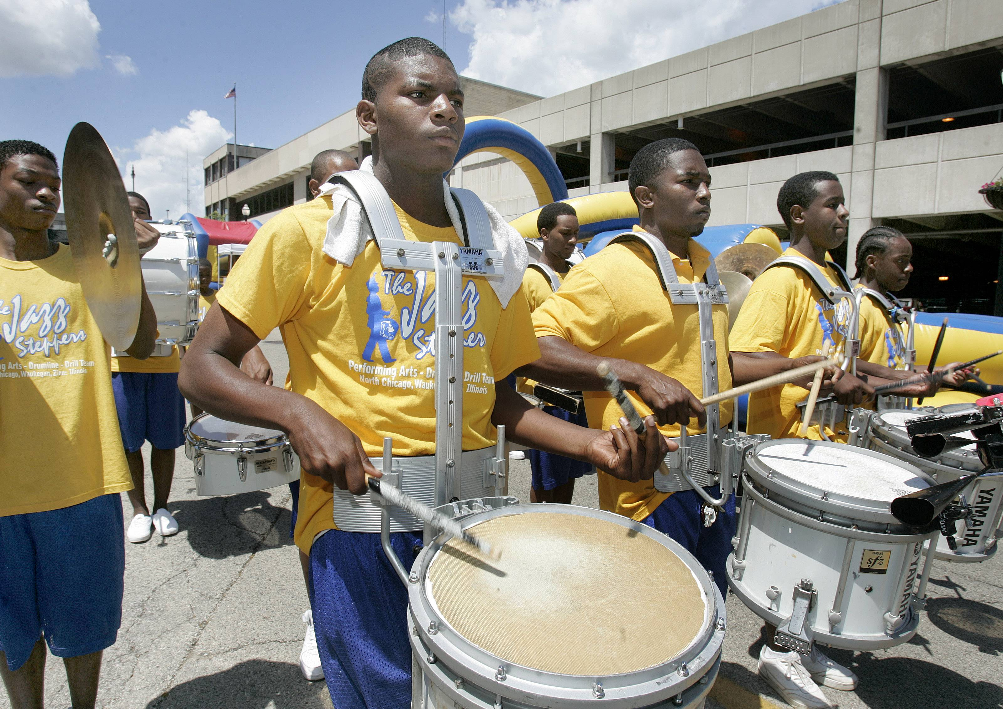 The Jazz Steppers drum line and drill team performs during the fifth annual Juneteenth Celebration in downtown Waukegan. This year marks Waukegan's 11th Juneteenth Celebration, commemorating the ending of slavery and saluting African American contributions to art, education and culture.
