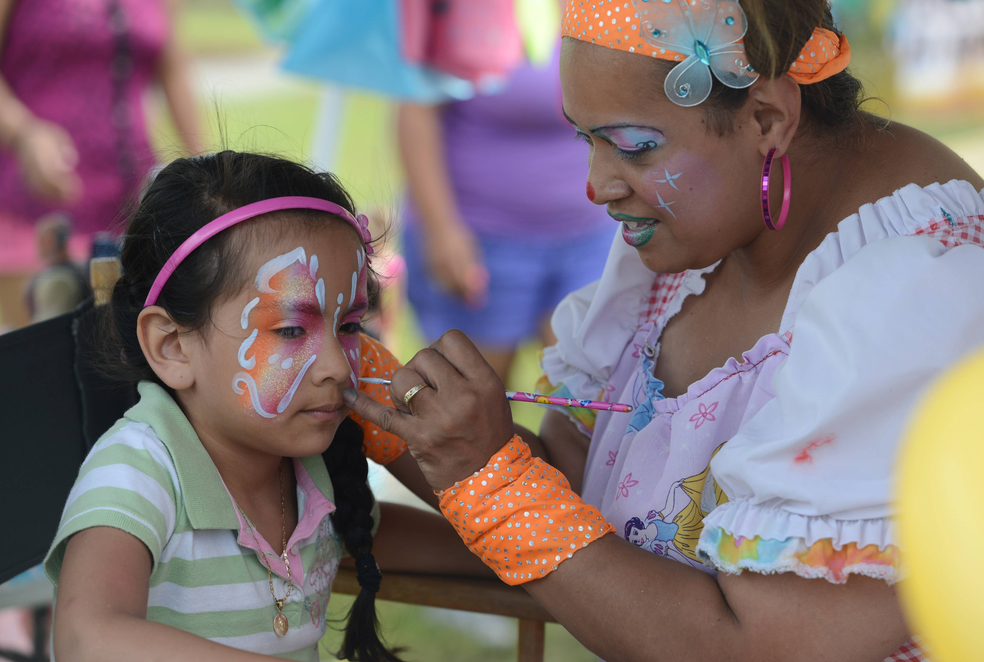 Pixie the Clown face paints children at last year's BeachFest celebration at the Cultural & Civic Center in Round Lake Beach.