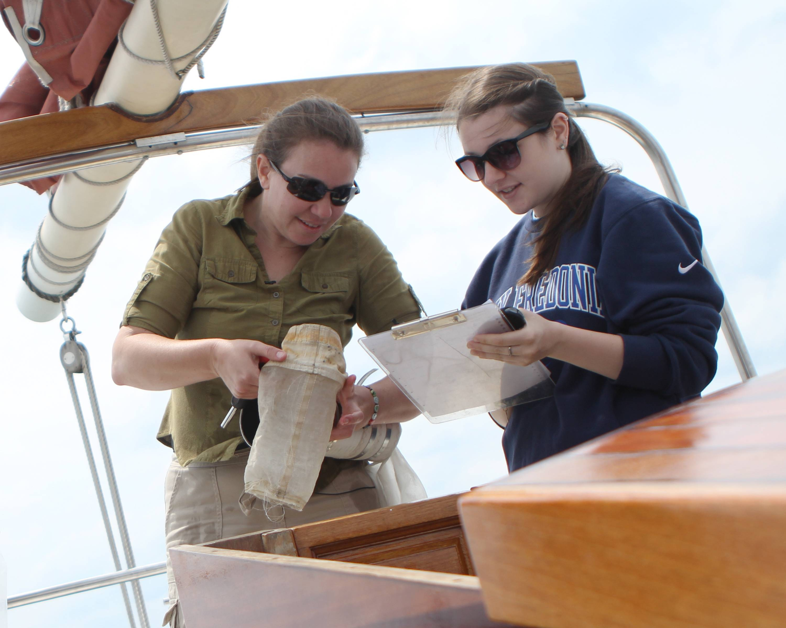 "Sherri Mason, left, a New York environmental scientist who led a research team studying microplastics in the Great Lakes, examines a trawling device used to collect plastic ""microbeads"" from the water's surface with SUNY-Fredonia student Rachel Ricotta in Lake Erie's Buffalo Harbor."
