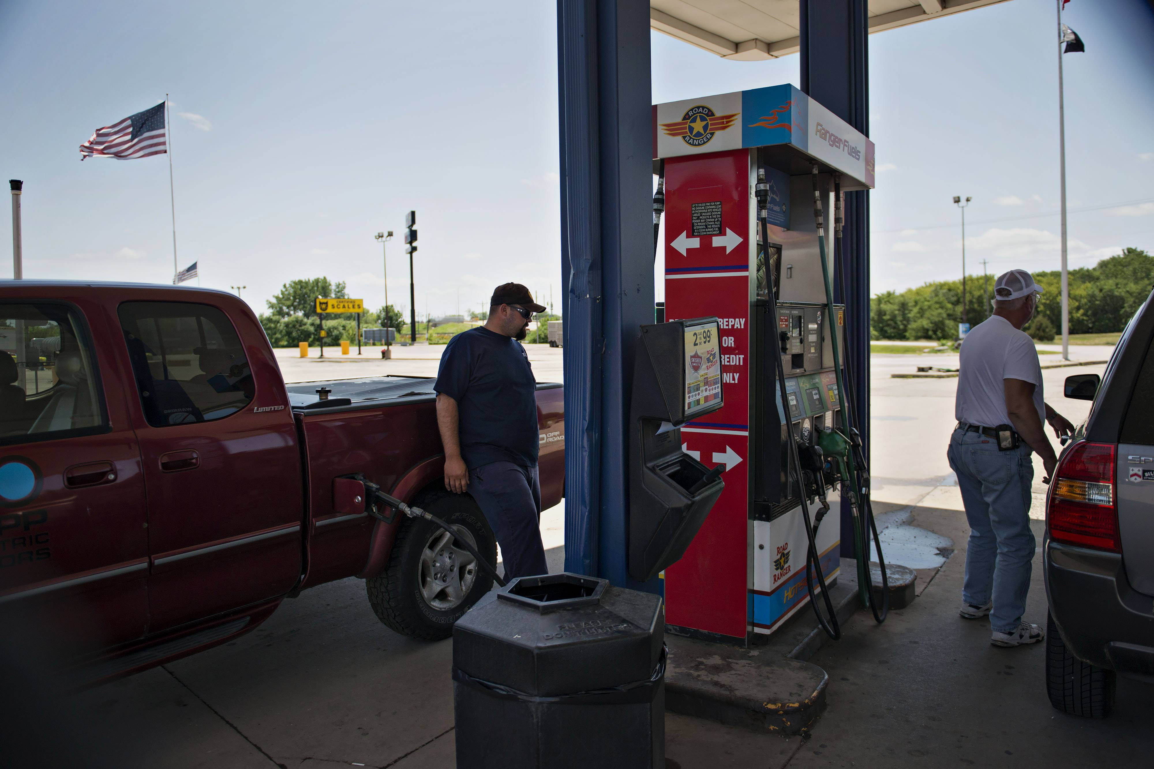 Customers purchase fuel Tuesday at a Road Ranger gas station in Princeton, Illinois. Lawmakers have been reluctant to raise fuel taxes despite calls from several blue-ribbon commissions to do so.