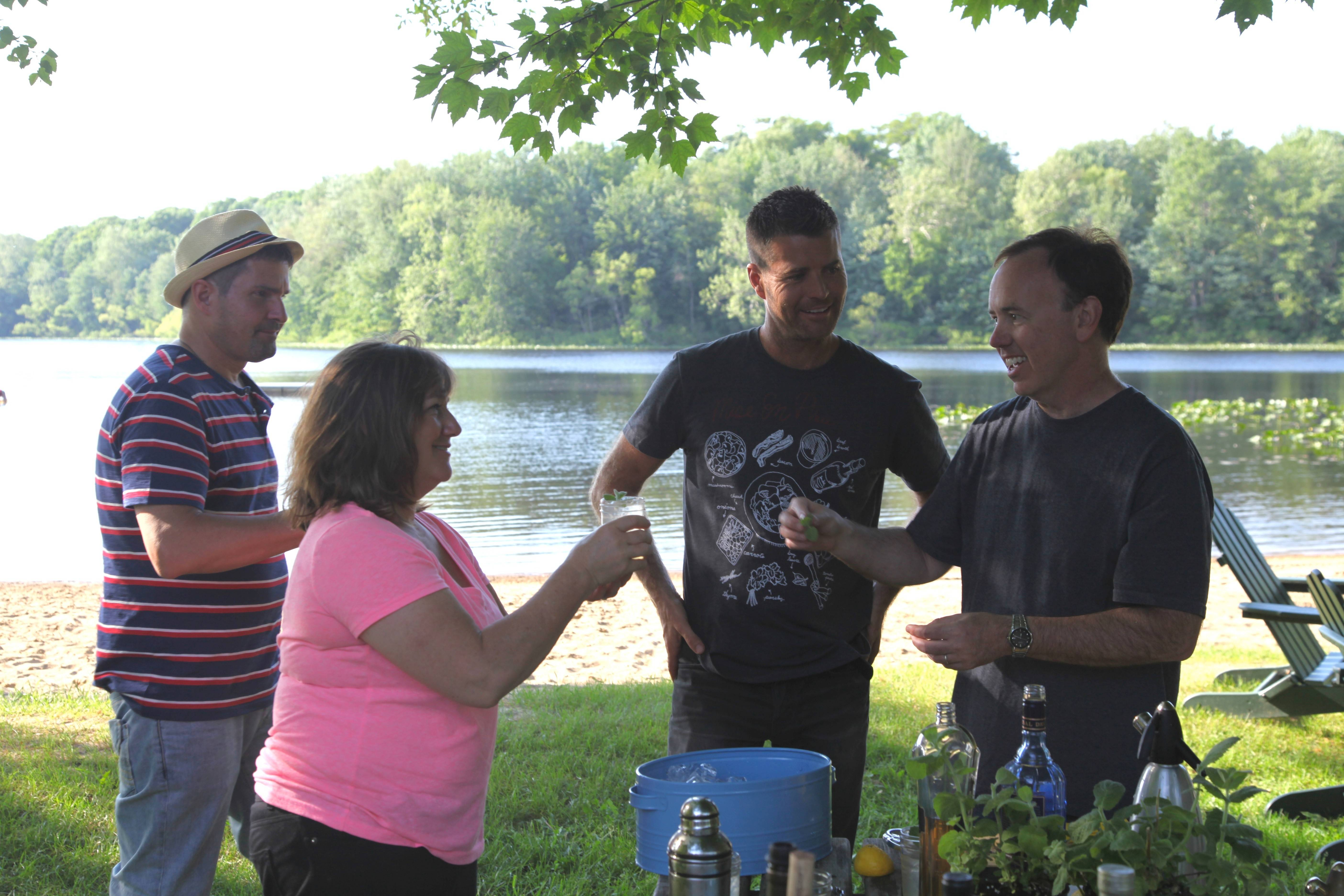 "Dan Smith, left, Gale Gand, Pete Evans and Steve McDonagh celebrate their day of taping ""A Moveable Feast with Fine Cooking"" with a gin cocktail. The show is scheduled to air this fall."