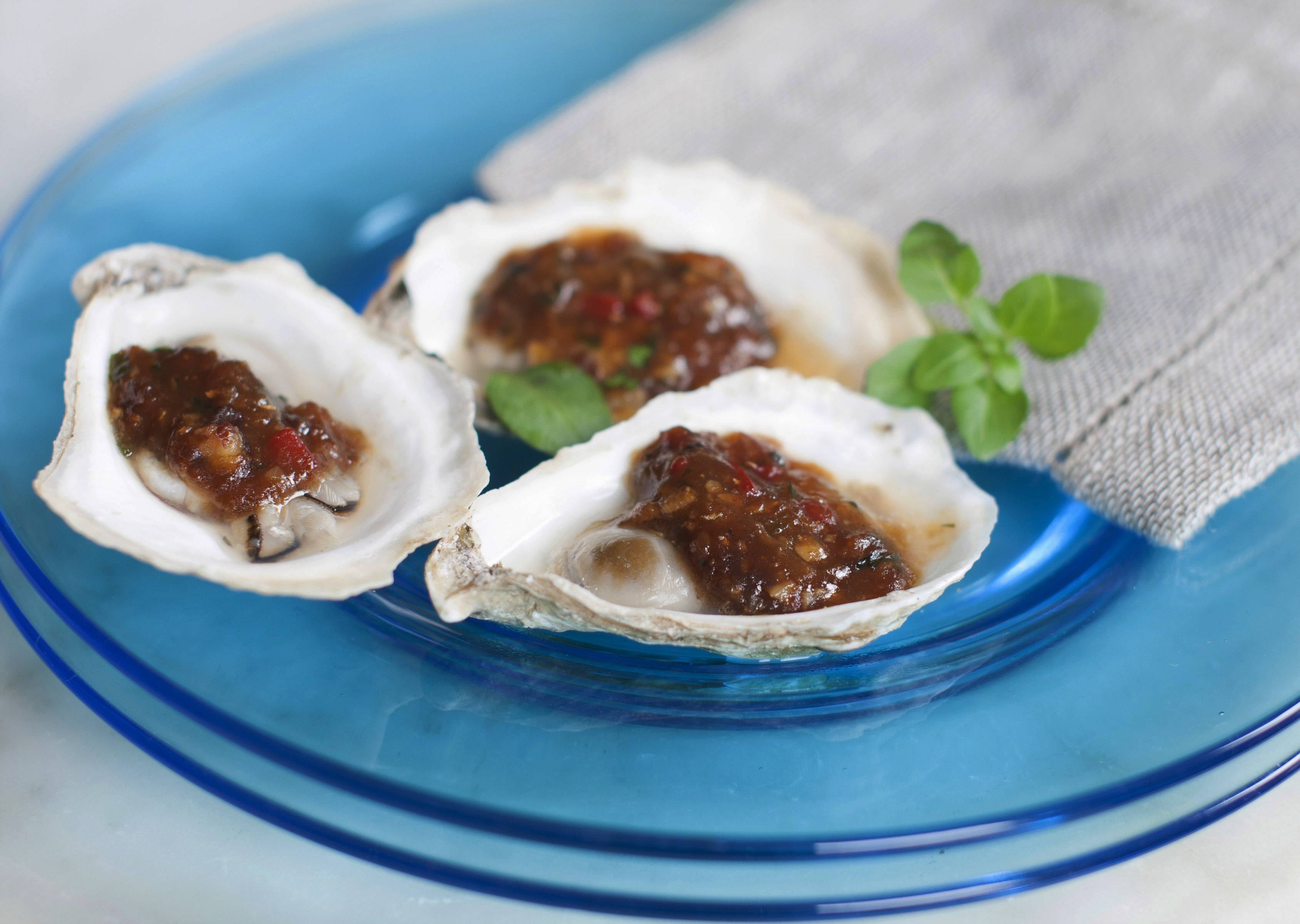Grilled Oysters With Miso Black Beans And Chili Garlic
