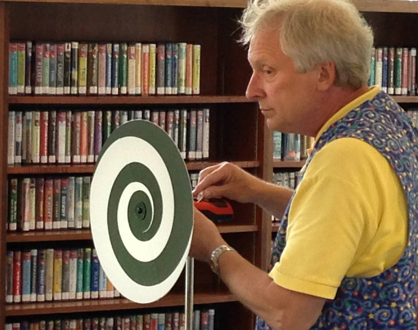 Magician Tim Glander performs a show about the magic of science Wednesday at the Town and Country Public Library in Elburn.