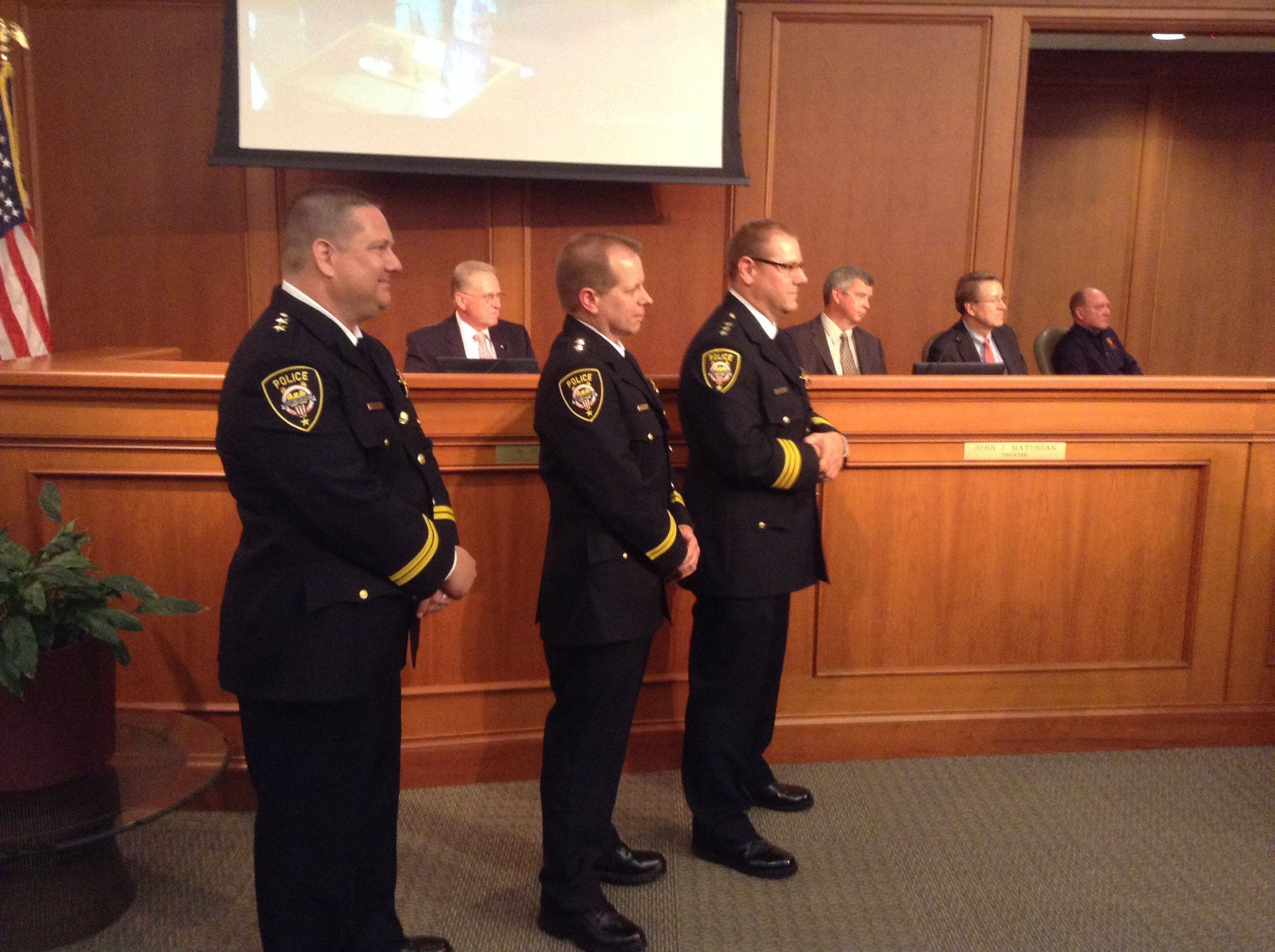 A new leadership team for the Mount Prospect Police Department took their oaths of office Tuesday in a ceremony before the village board. the group includes, from left, Deputy Chief Timothy Griffin, Deputy Chief Michael Eterno and Chief Timothy Janowick.