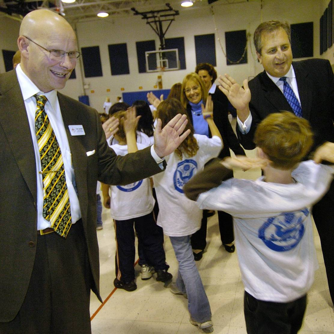District 220 Superintendent Tom Leonard, left, attended his final school board meeting in Barrington Tuesday night. Amid the tributes, district spokesman Jeff Arnett praised Leonard's engaging personality. Here, Leonard and board President Brian Battle greet students from Lines School in 2008.