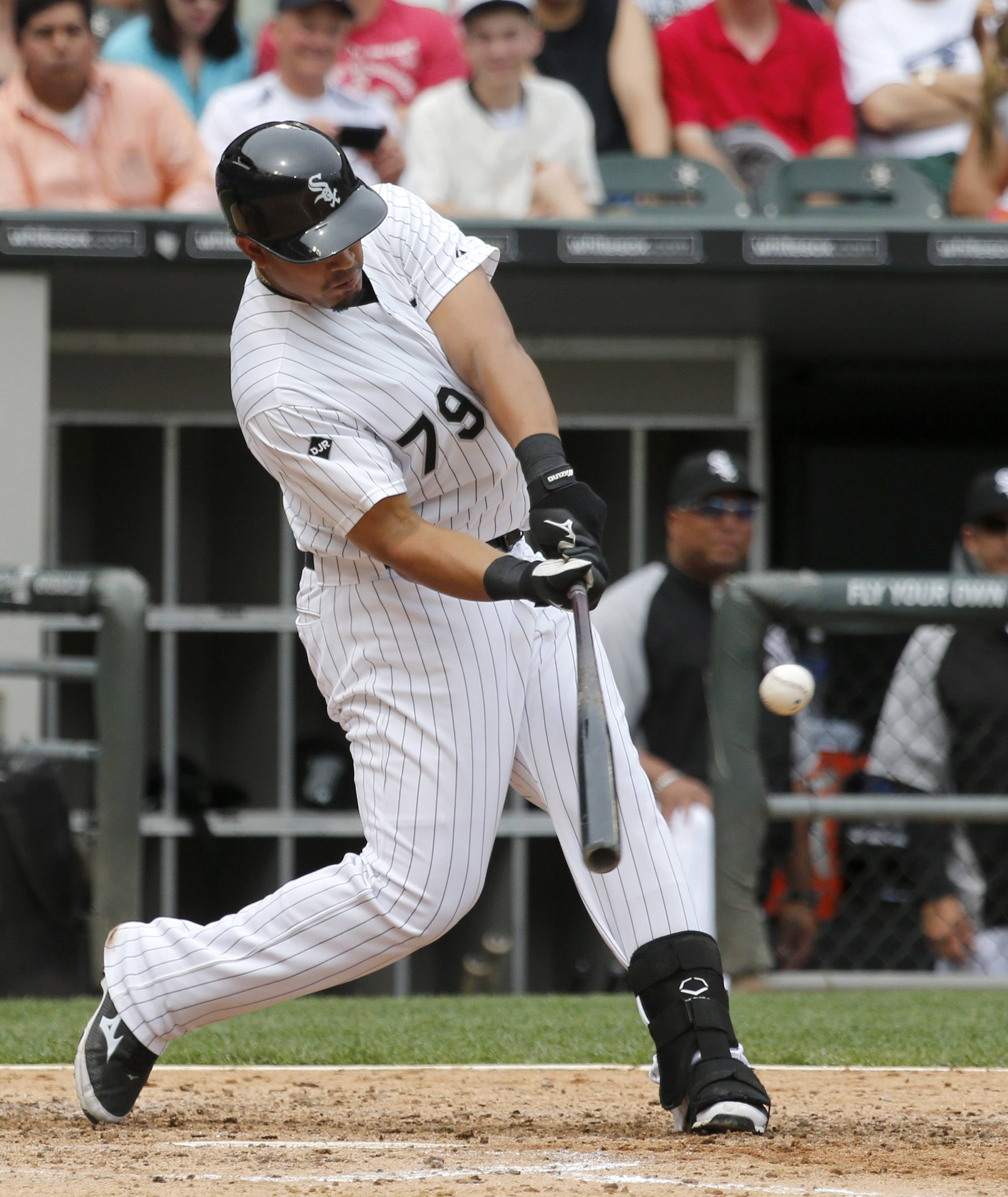 Chicago White Sox's Jose Abreu hits a single off San Francisco Giants starting pitcher Tim Hudson during the fifth inning of an interleague baseball game Wednesday, June 18, 2014, in Chicago. (AP Photo/Charles Rex Arbogast)