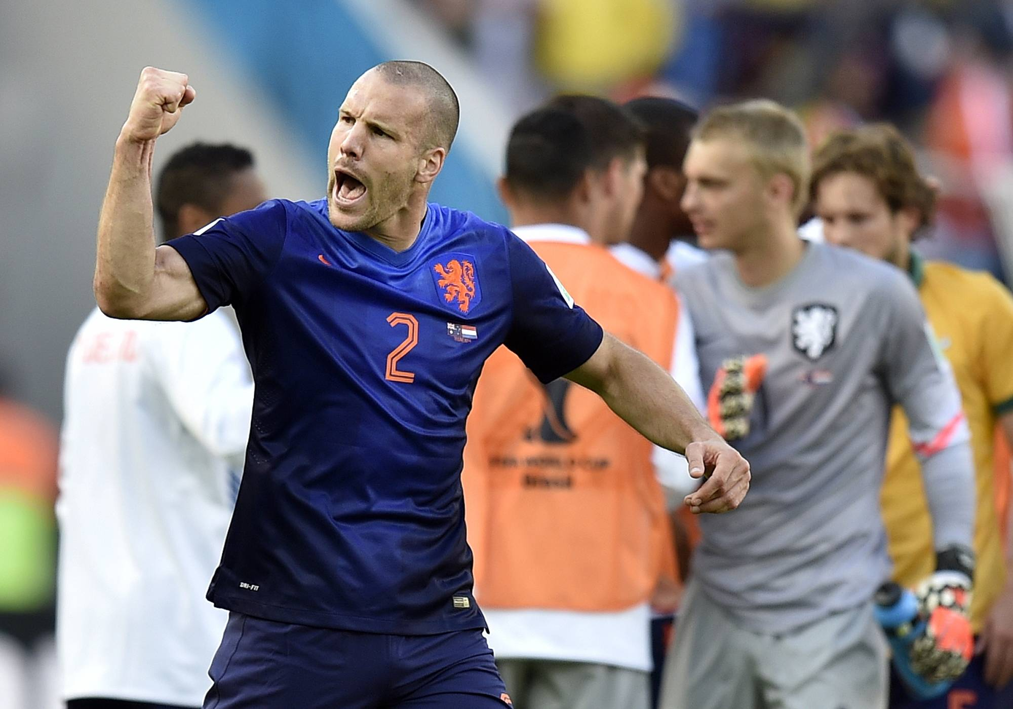 Netherlands' Ron Vlaar celebrates after the group B World Cup soccer match between Australia and the Netherlands at the Estadio Beira-Rio in Porto Alegre, Brazil, Wednesday, June 18, 2014. The Netherlands won the match 3-2. (AP Photo/Martin Meissner)