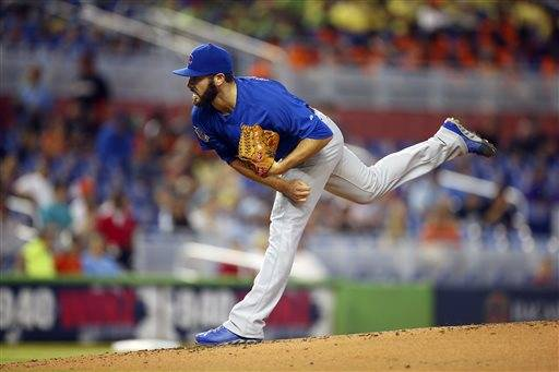 "Jake Arrieta made it look easy, then made it sound easy. The Cubs right-hander had a career-high 11 strikeouts in seven innings to beat the Miami Marlins 6-1 on Wednesday. Arrieta (3-1) lowered his ERA to 1.98, and he has 55 strikeouts in 50 innings. ""I'm not doing anything different,"" he said. ""I'm just commanding everything down in the strike zone and trying to force early contact. Strikeouts are just a byproduct of throwing several plus pitches for strikes."""