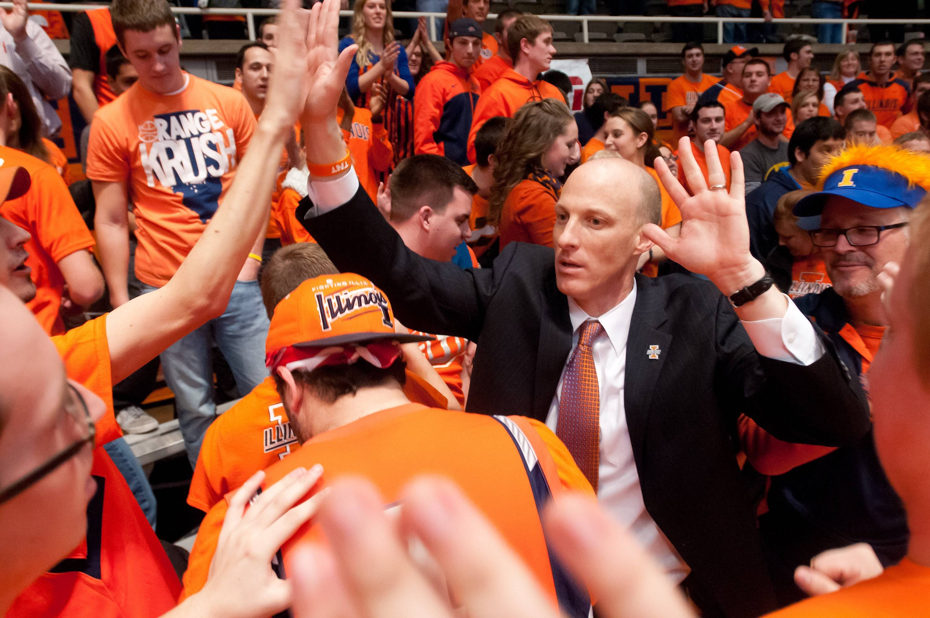 While Illinois and head coach John Groce, right, beat Indiana last December in Champaign, the Hoosiers led the Big Ten in attendance and finished sixth in attendance nationally. Illinois finished 15th in attendance nationally.