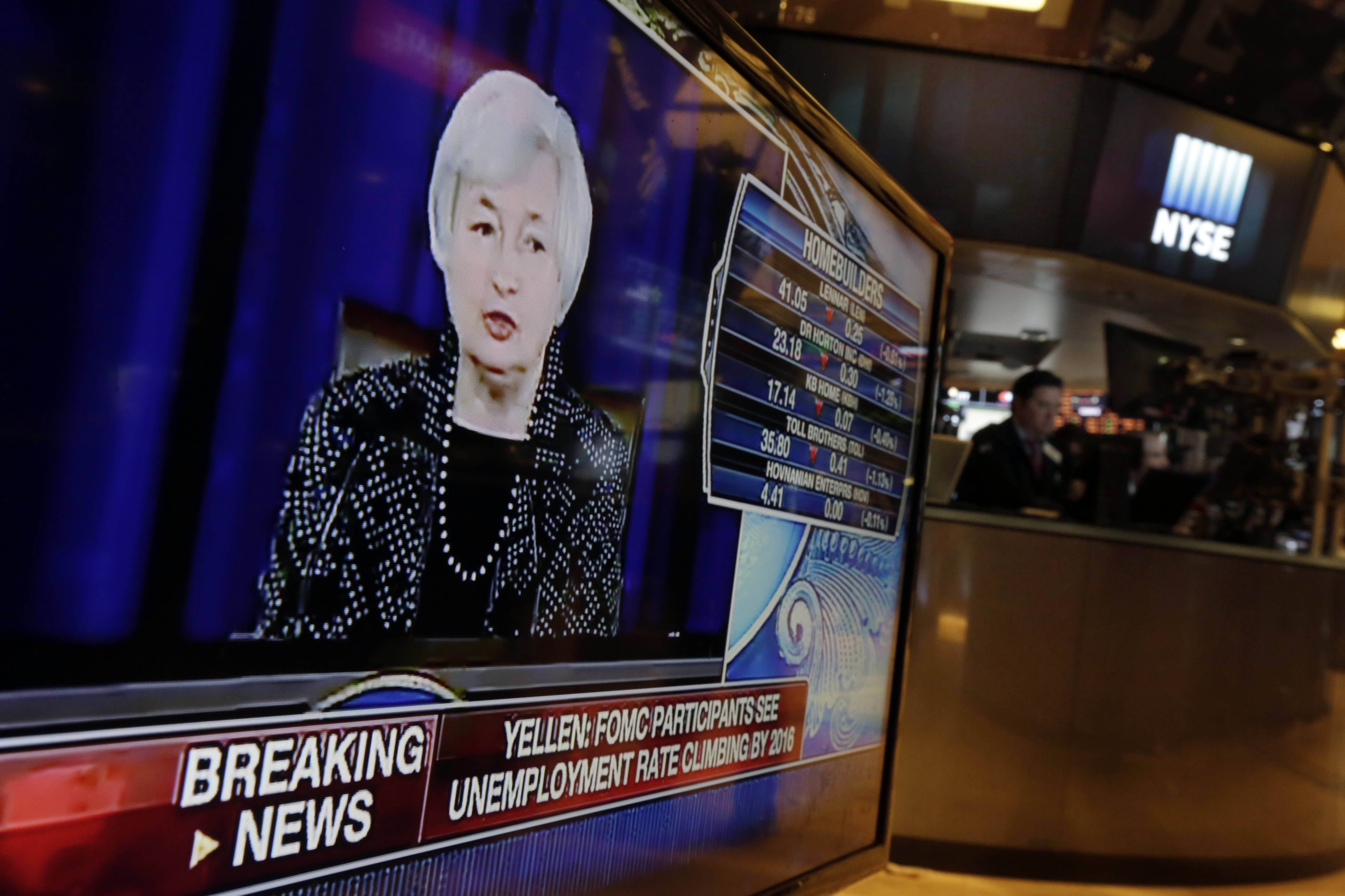 Federal Reserve Chair Janet Yellen's news conference Wednesday appears on a television monitor on the floor of the New York Stock Exchange.