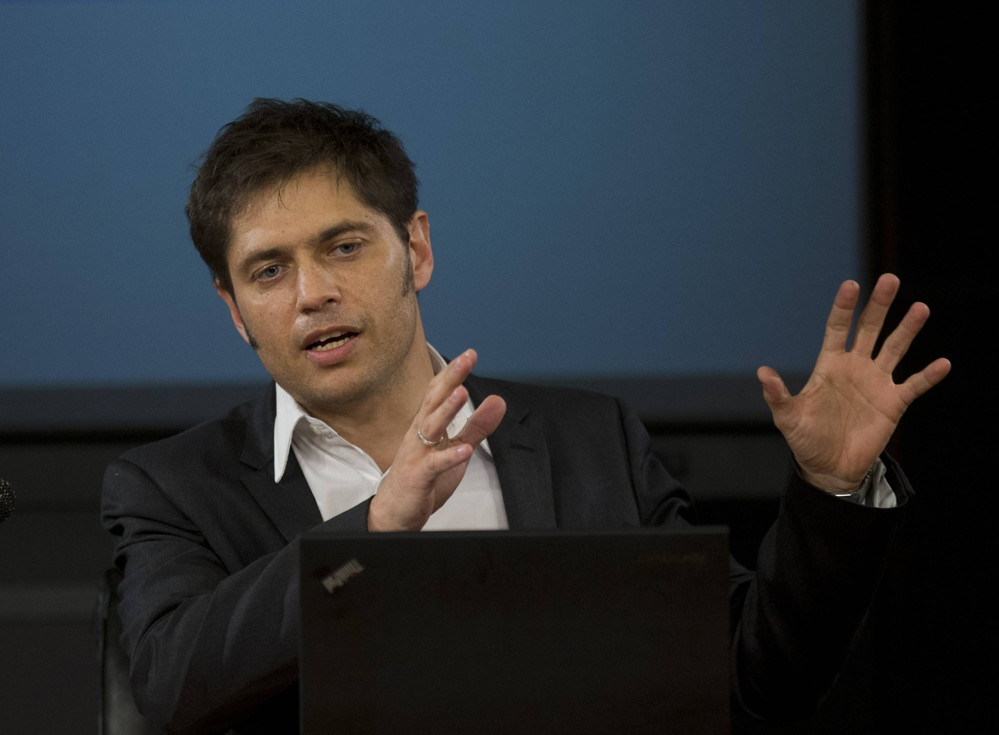 Argentina's Economy MInister Axel Kicillof talks to the media Tuesday. He says the government is working on a debt swap that would make payments in Argentina to creditors who accepted previous debt restructurings.