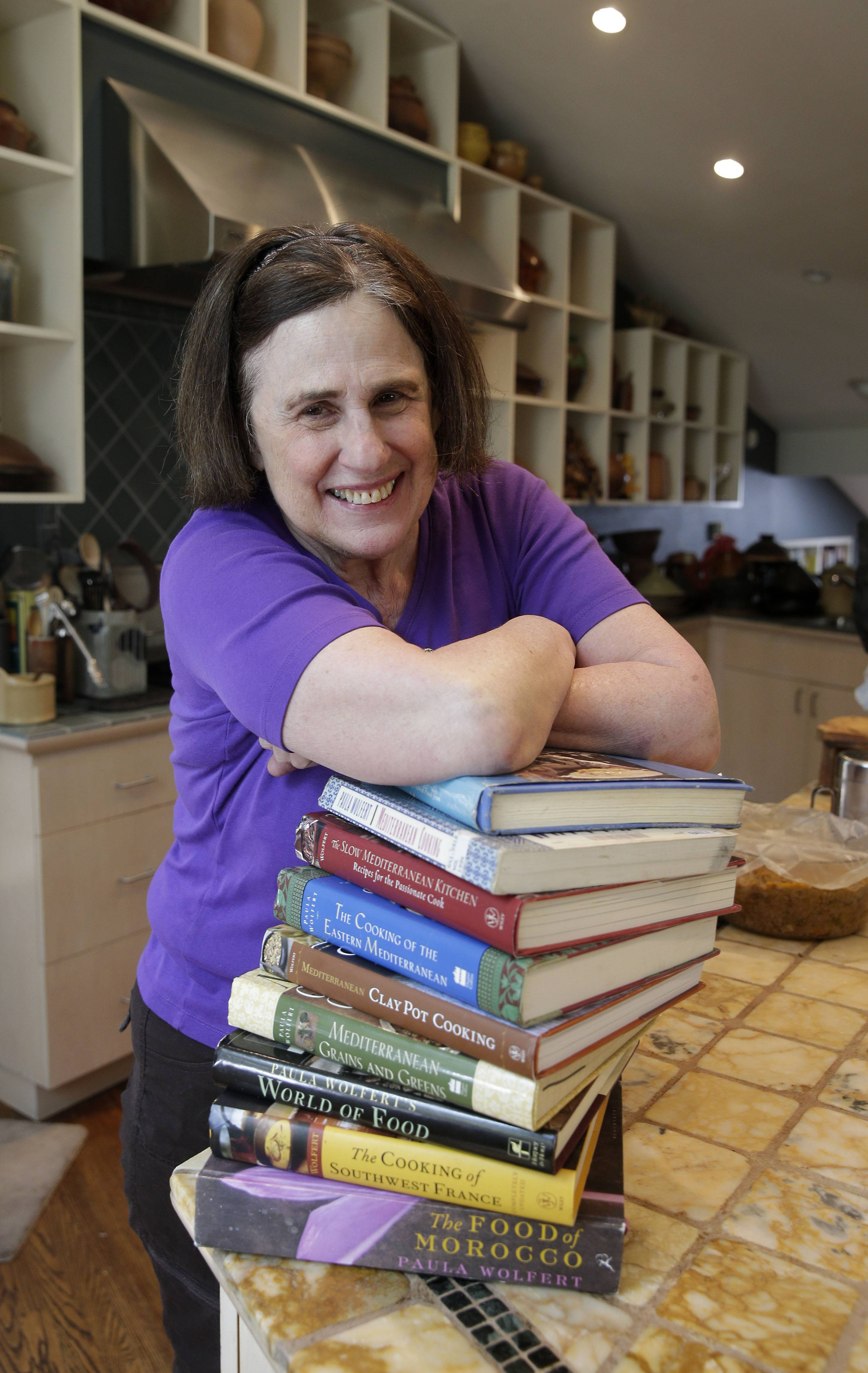 Cookbook author Paula Wolfert shows off some of her cookbooks at her home in Sonoma, Calif. in May.