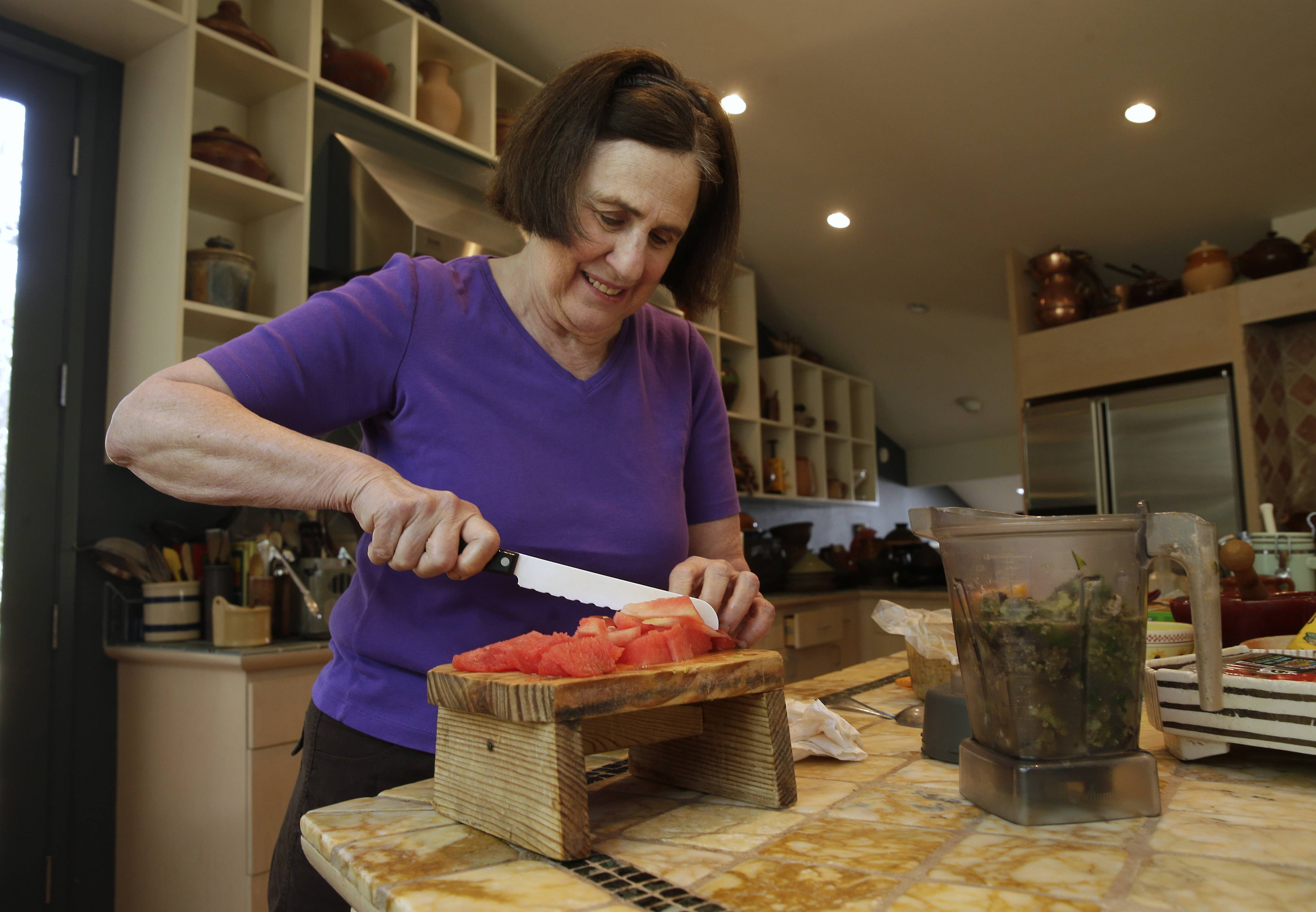 Cookbook author Paula Wolfert cuts up watermelon for use in a smoothie mix at her home in Sonoma, Calif.