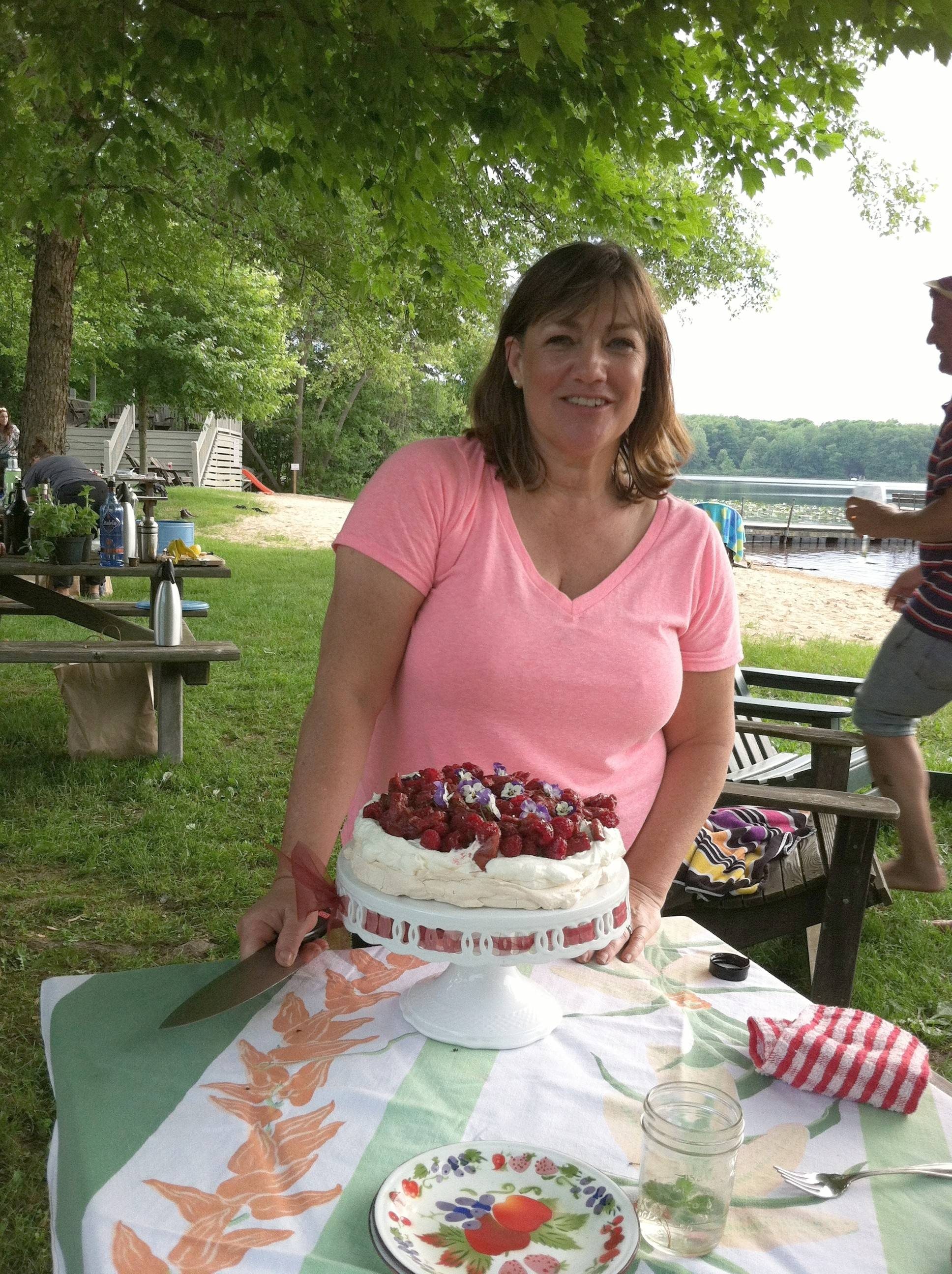 Chef Gale Gand presents her roasted rhubarb and raspberry Pavlova at the end of a meal created from ingredients sourced in southwestern Michigan.
