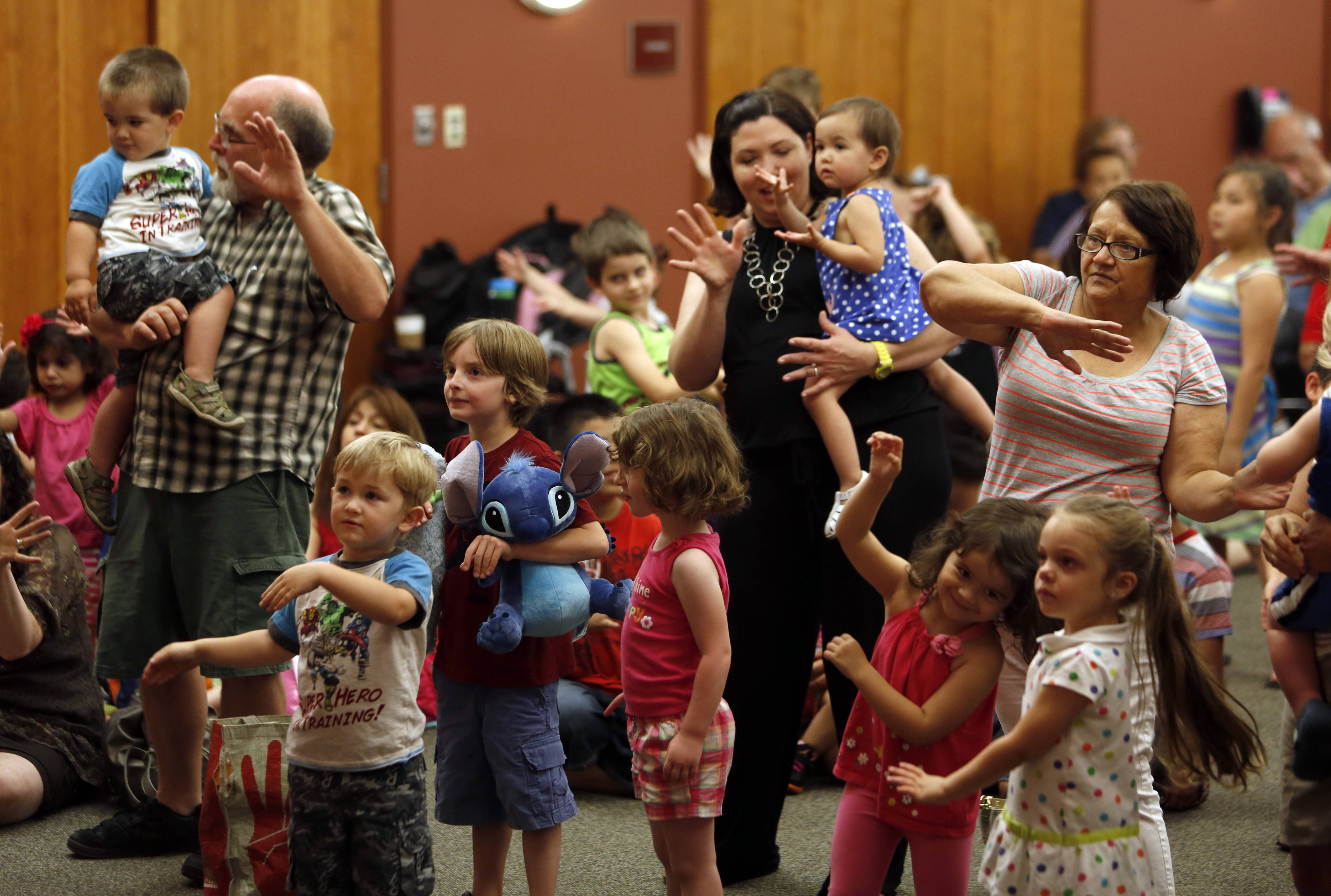 Children and parents got into the swing of things during a visit from WTTW-TV's Miss Lori at Gail Borden Public Library in Elgin..