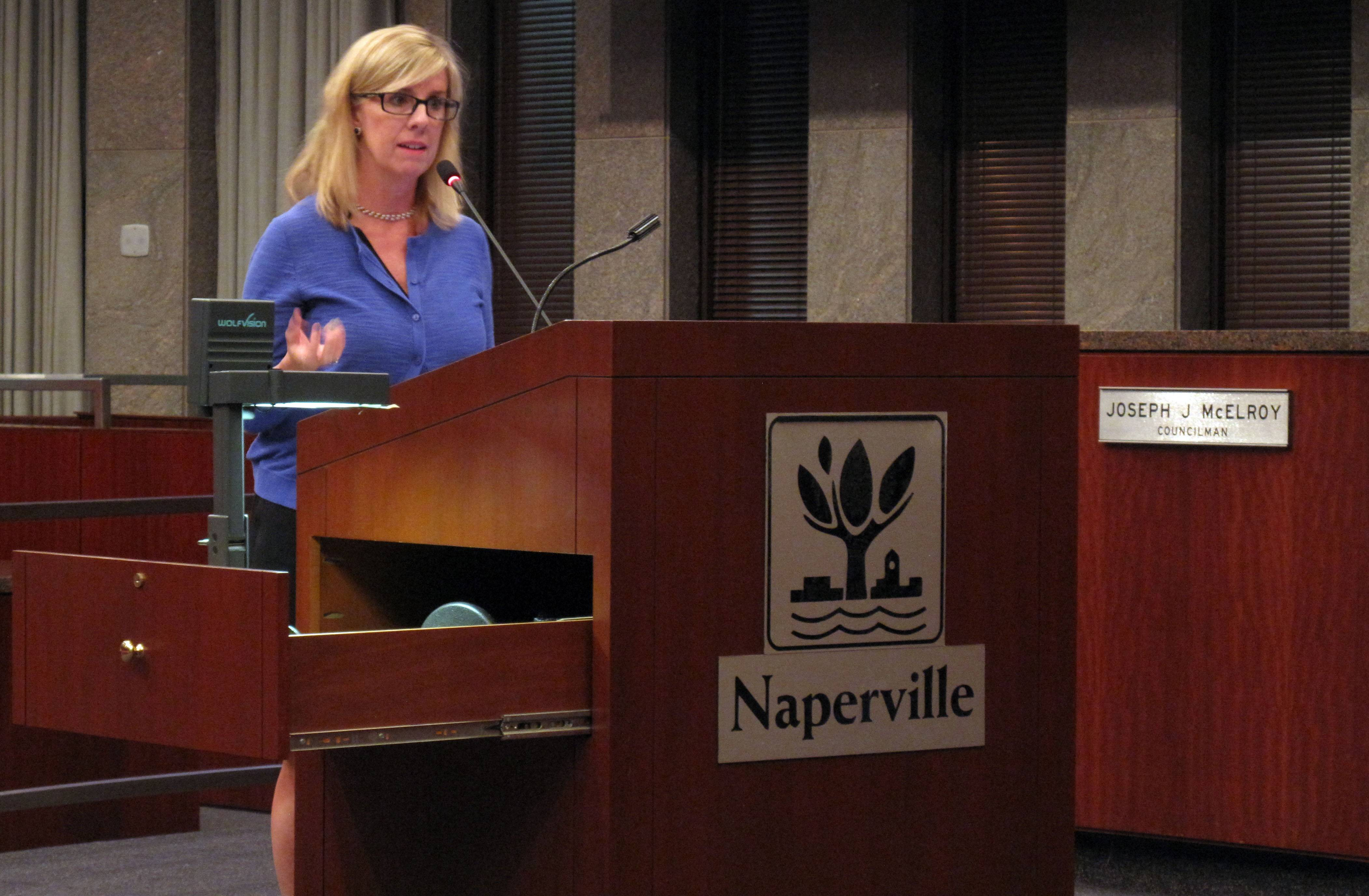 "Katie Wood, executive director of the Downtown Naperville Alliance, tells city council members Tuesday night that a new sound system being considered for the central business district would be used to provide ""mainstream, pleasing"" background music primarily during special events."