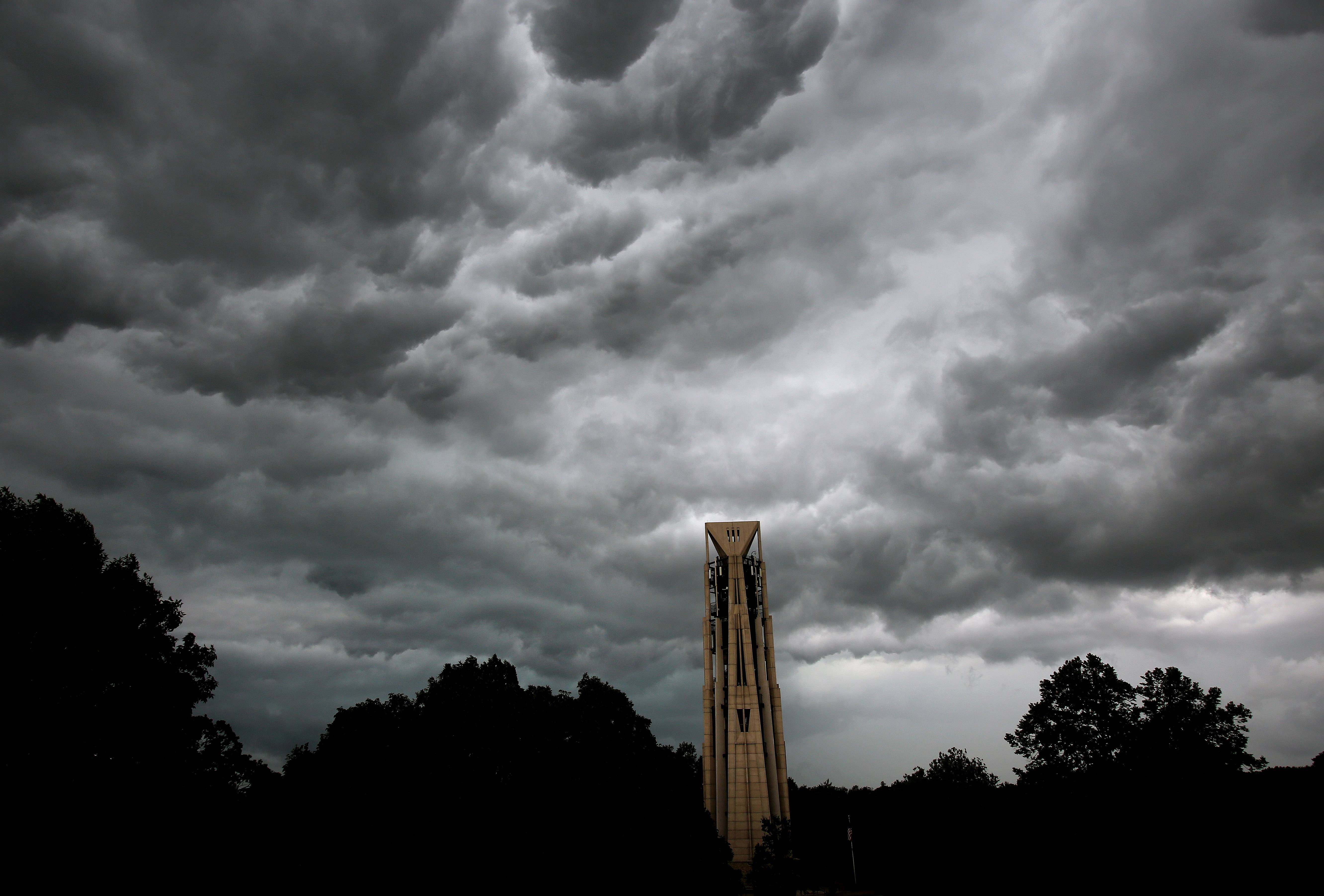 Storm clouds move through downtown Naperville on Wednesday.