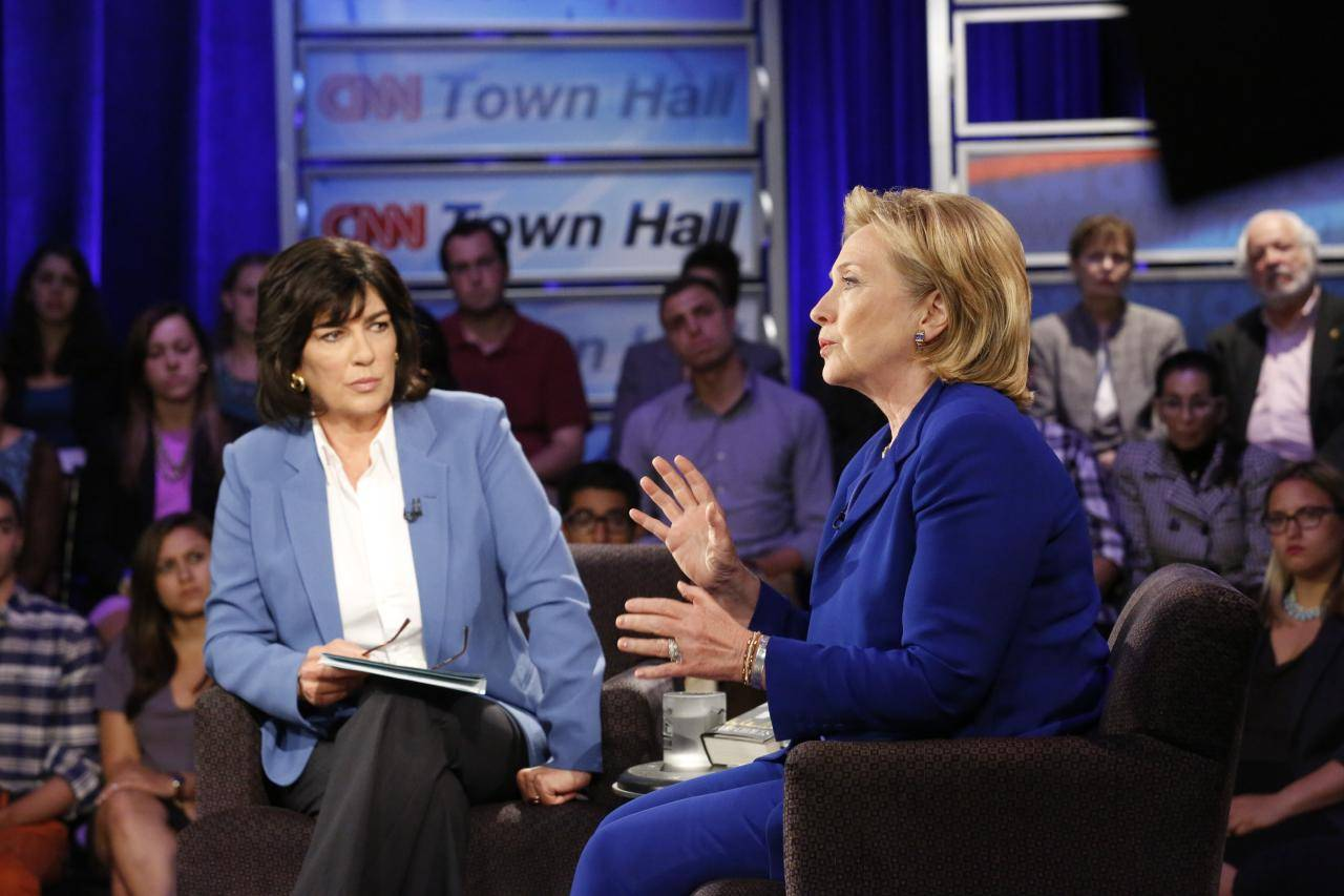 "Hillary Rodham Clinton speaks Tuesday during CNN's Town Hall interview in New York. The former secretary of state expressed caution Tuesday about the United States working with Iran to combat fast-moving Islamic insurgents in Iraq, saying the U.S. needs to understand ""what we're getting ourselves into."""