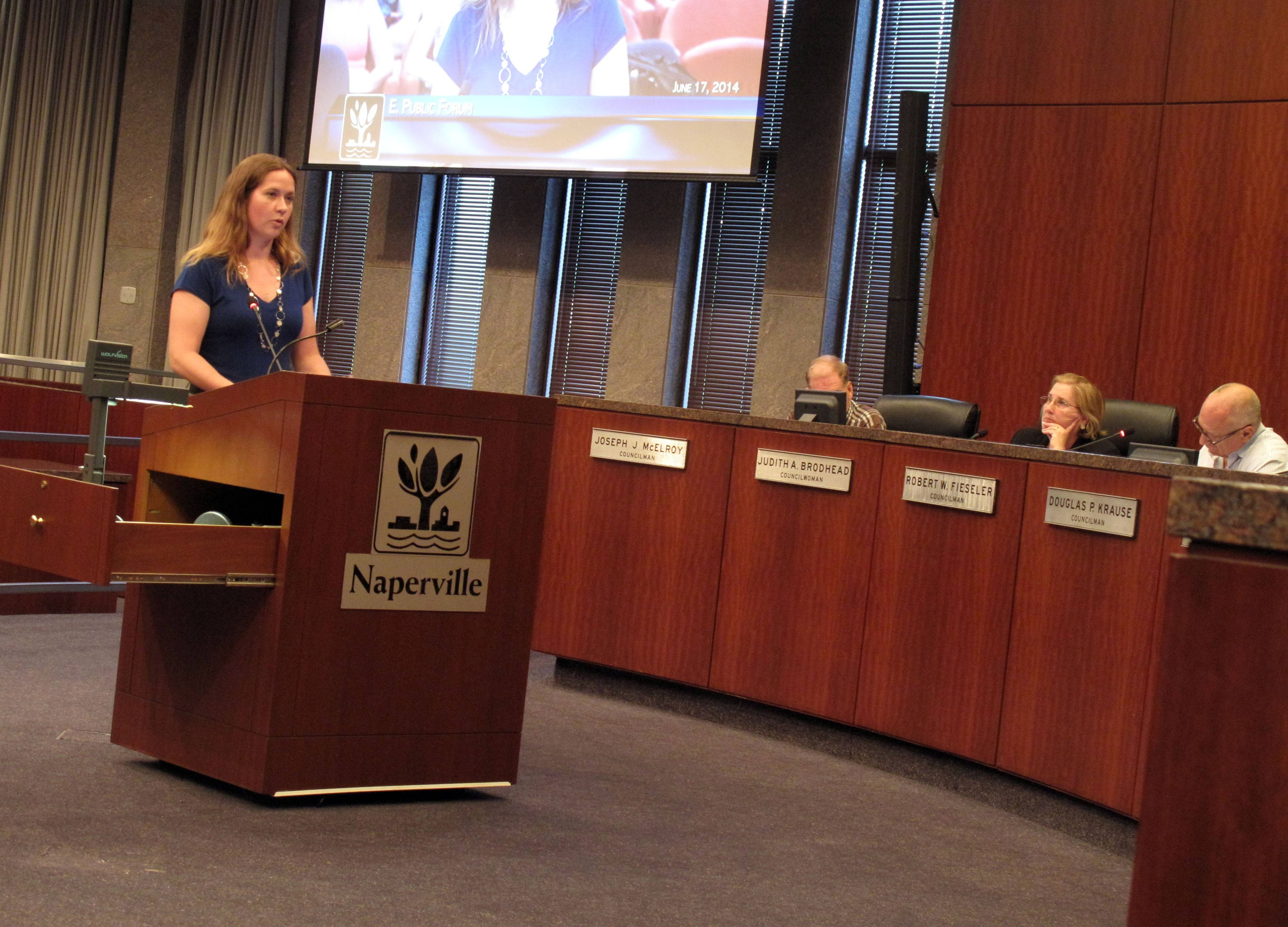 Anna Payton, executive director of the Naperville Area Humane Society, asks the Naperville City Council to consider banning the sale of pets from so-called puppy mills.