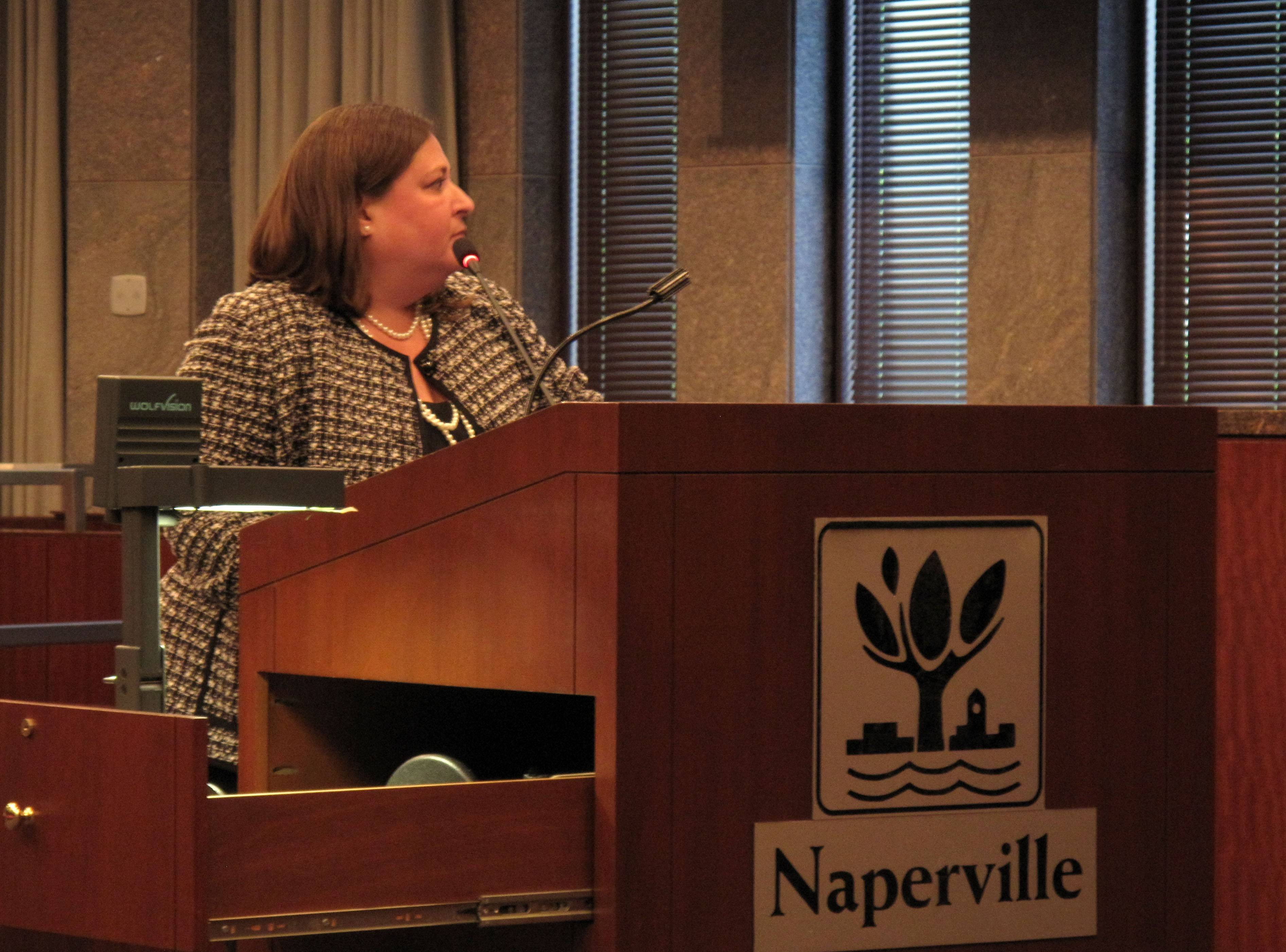 Sherri Oslick of Naperville asks Naperville City Council members to ban the sale of puppies from so-called puppy mills during a meeting Tuesday night. She was one of nine speakers to address the topic, which is scheduled to be discussed again Aug. 19.