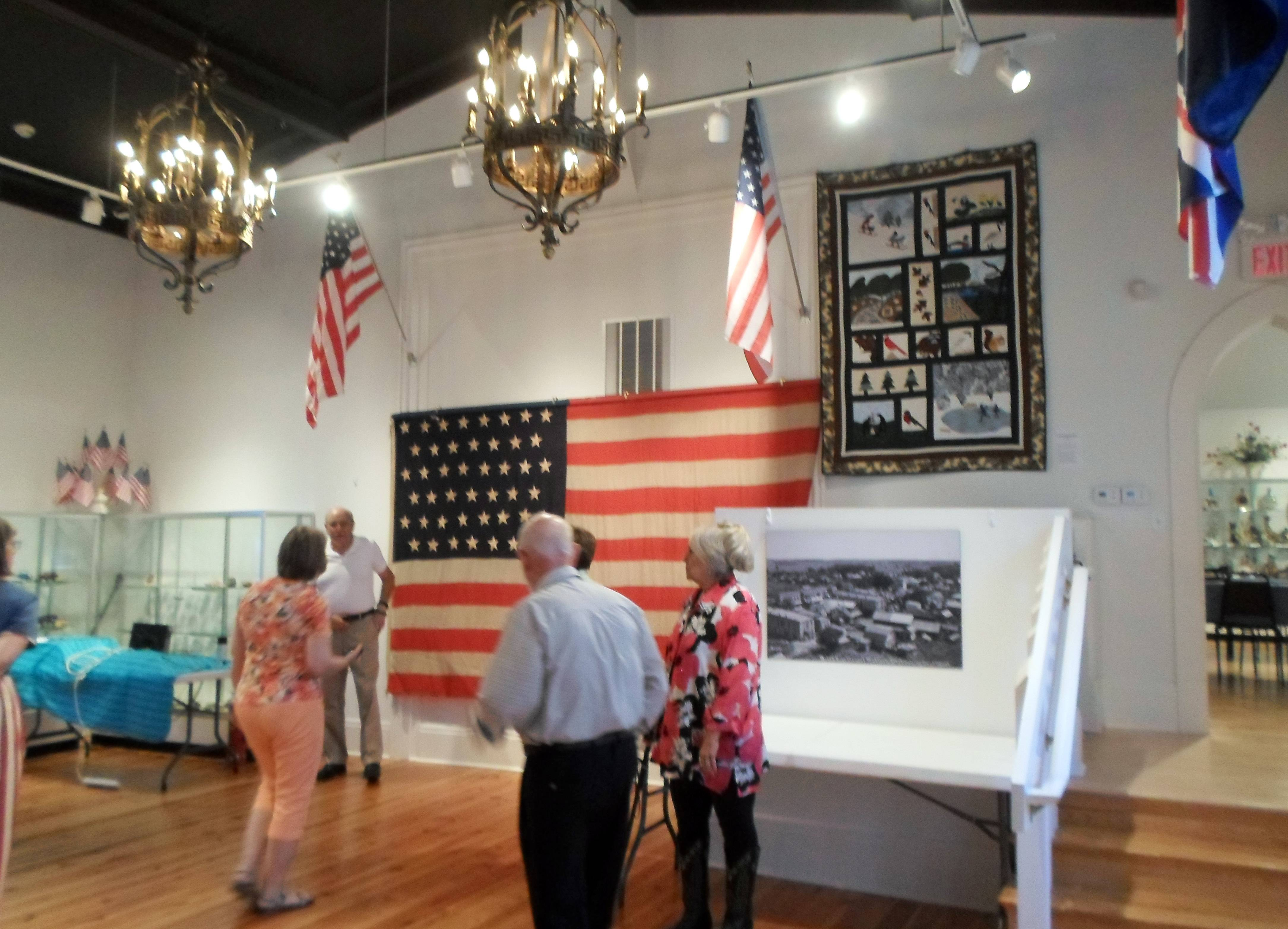 A large American flag is displayed at the Lakes Region Historical Society in Antioch.