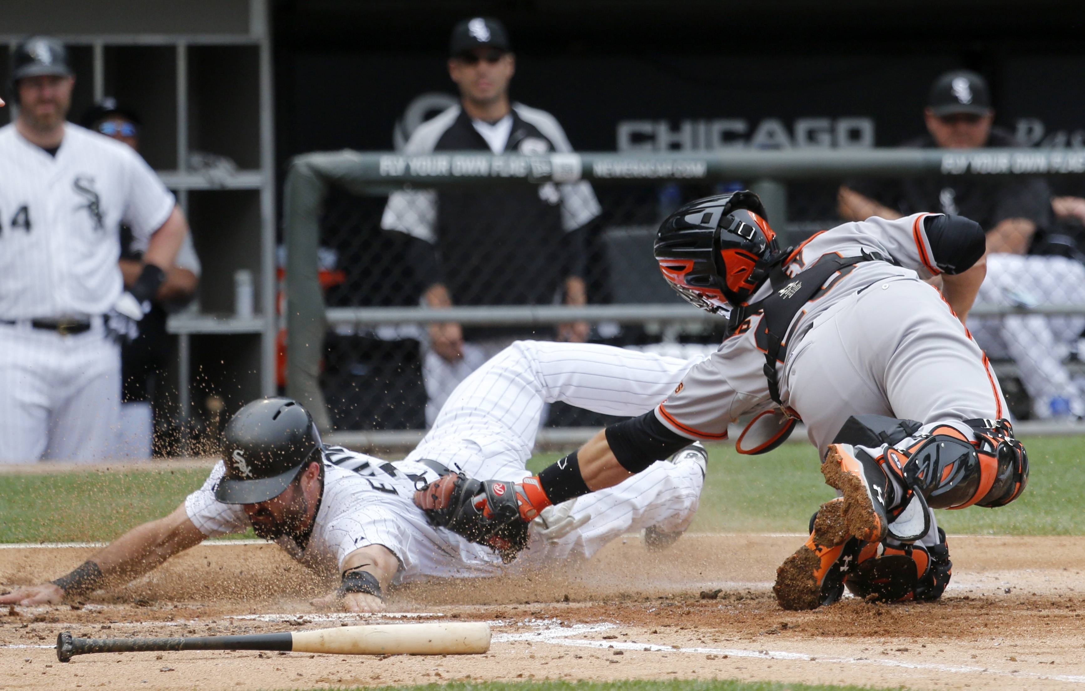 Giants catcher Buster Posey tags out Adam Eaton of the White Sox in the third inning Wednesday at U.S. Cellular Field.