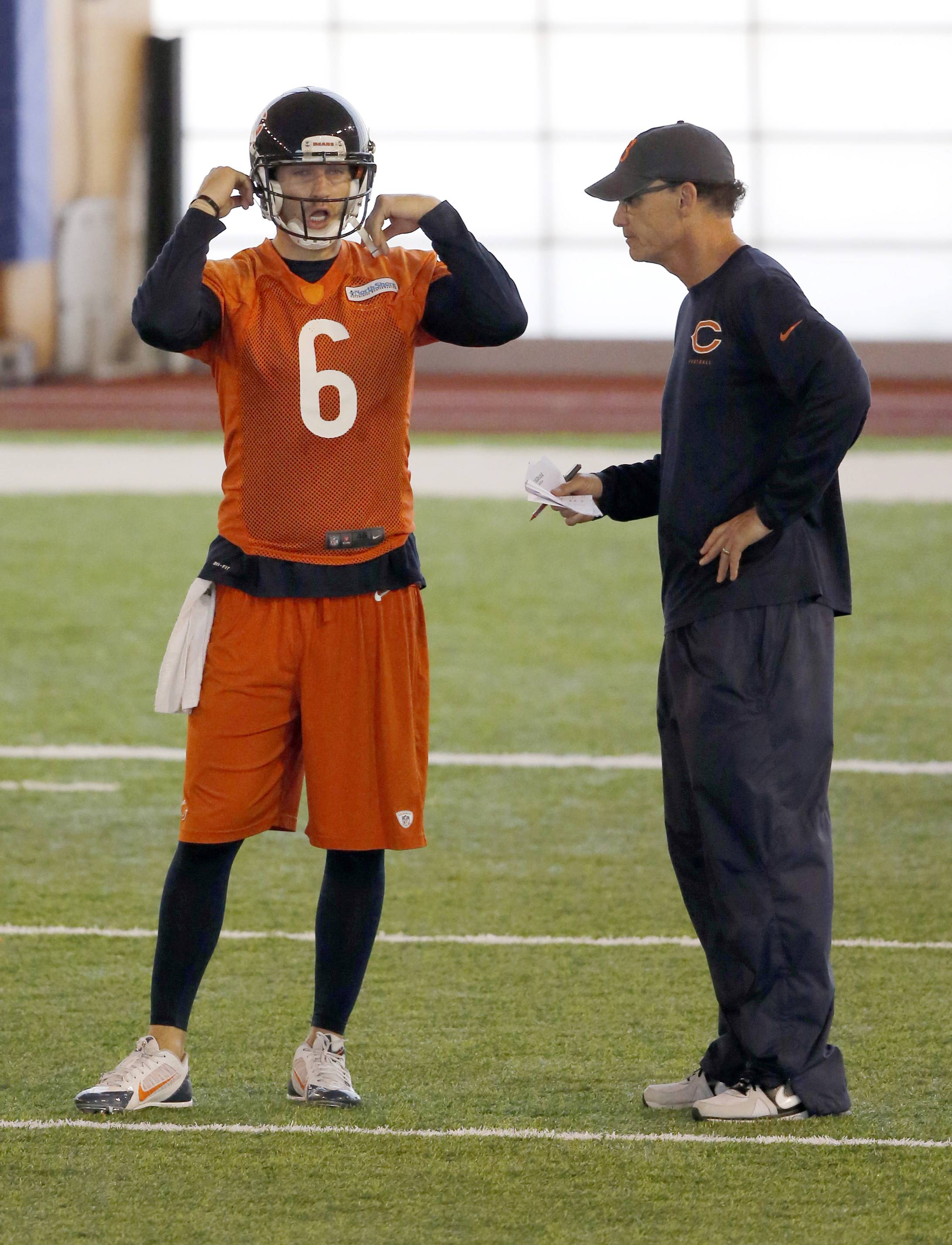 Bears quarterback Jay Cutler talks to head coach Marc Trestman during Tuesday's minicamp session in Lake Forest.